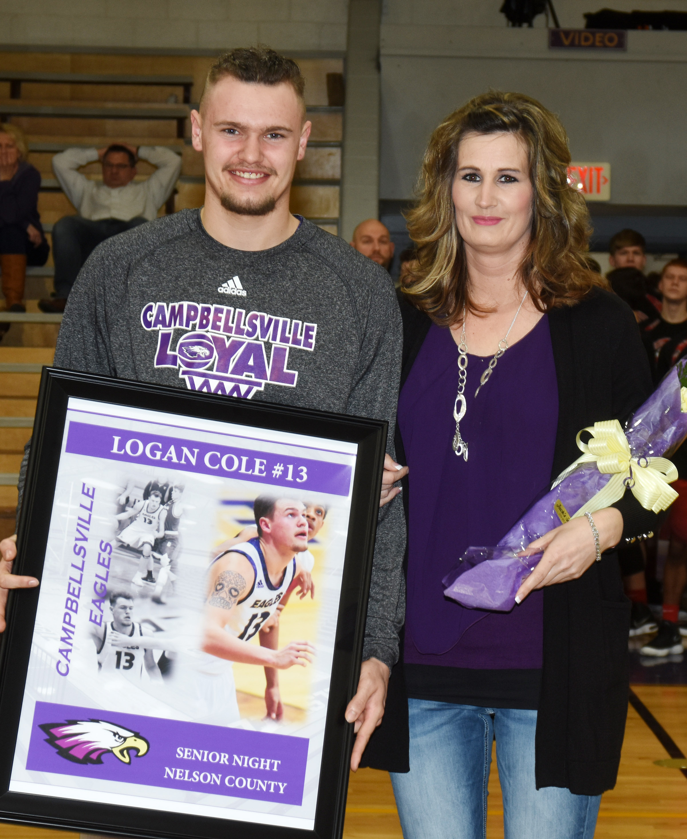 CHS senior boys' basketball player Logan Cole is honored. He is pictured with his mother, Stacie Lay.