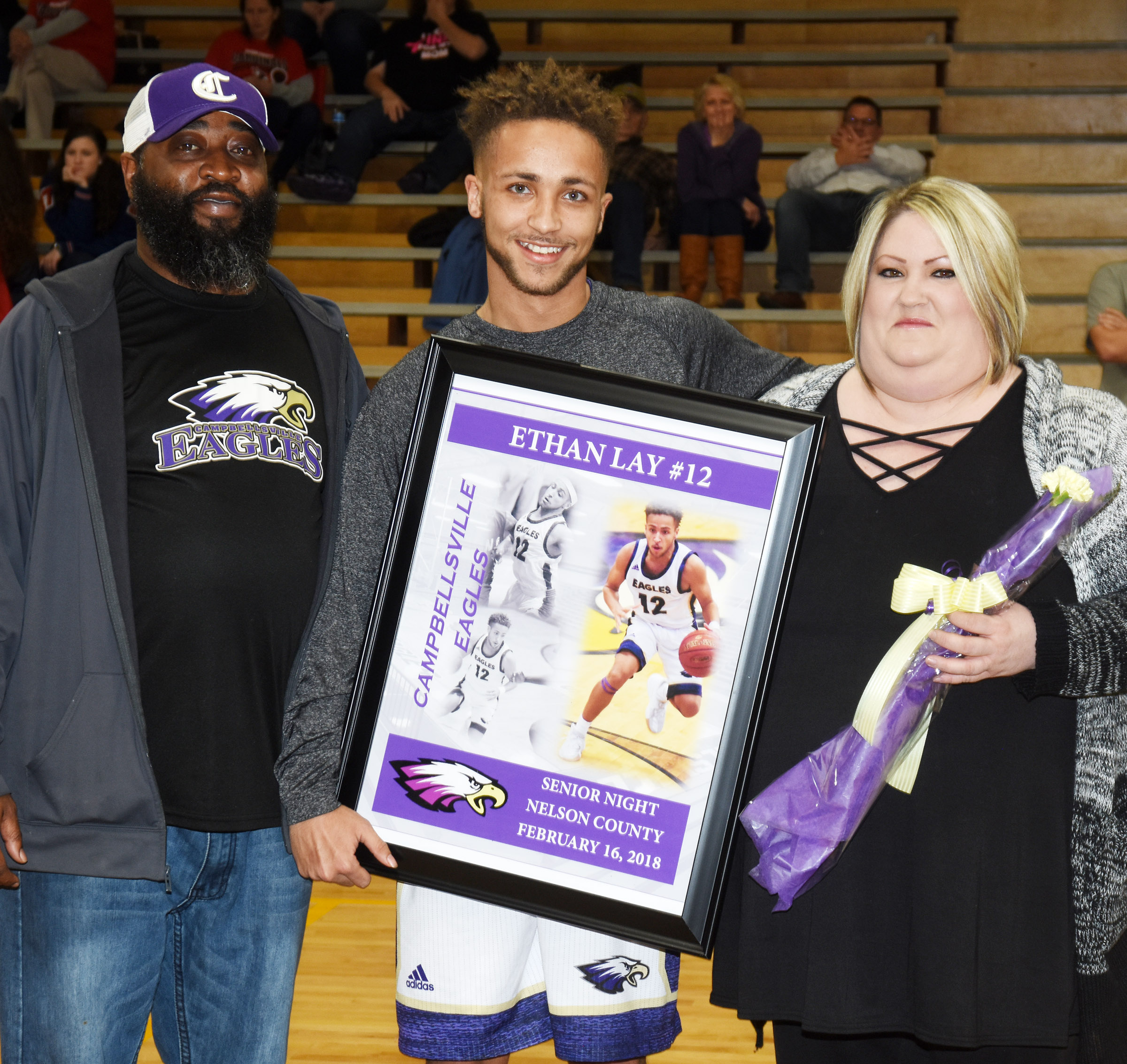CHS senior boys' basketball player Ethan Lay is honored. He is pictured with his parents, Andree Johnson and Ashley Lay.