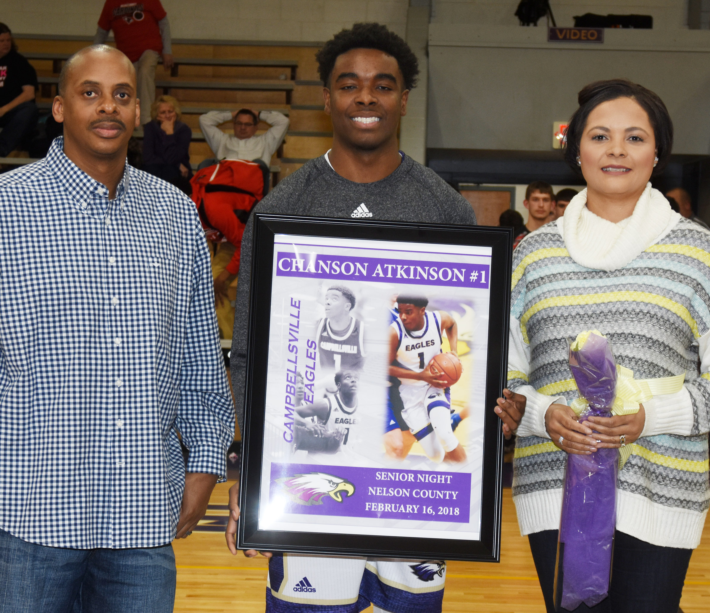 CHS senior boys' basketball player Chanson Atkinson is honored. He is pictured with his parents Al and Rochelle Brady.