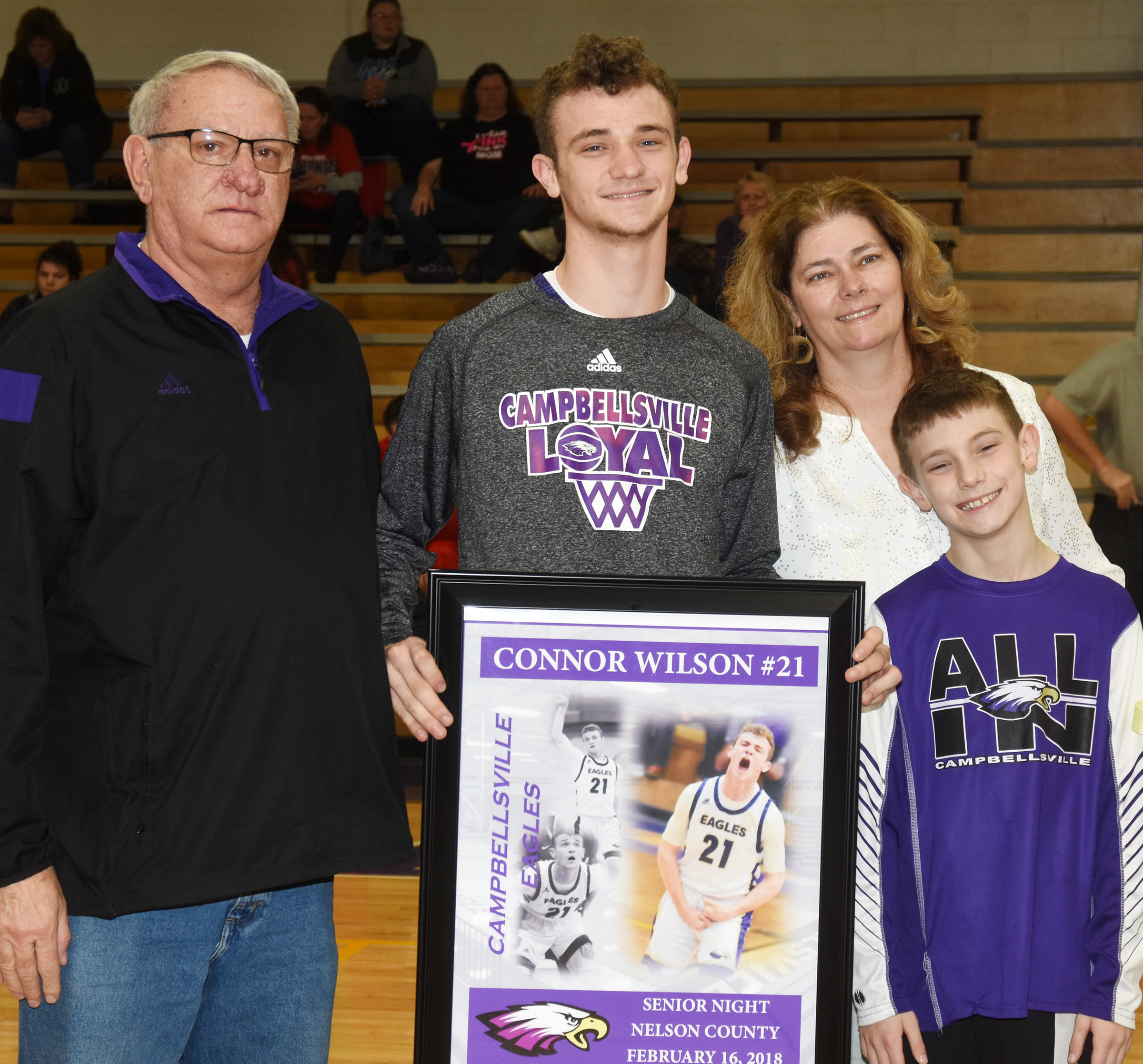 CHS senior boys' basketball player Connor Wilson is honored. He is pictured with his parents Rick and Tammy Wilson, and brother Aidan.