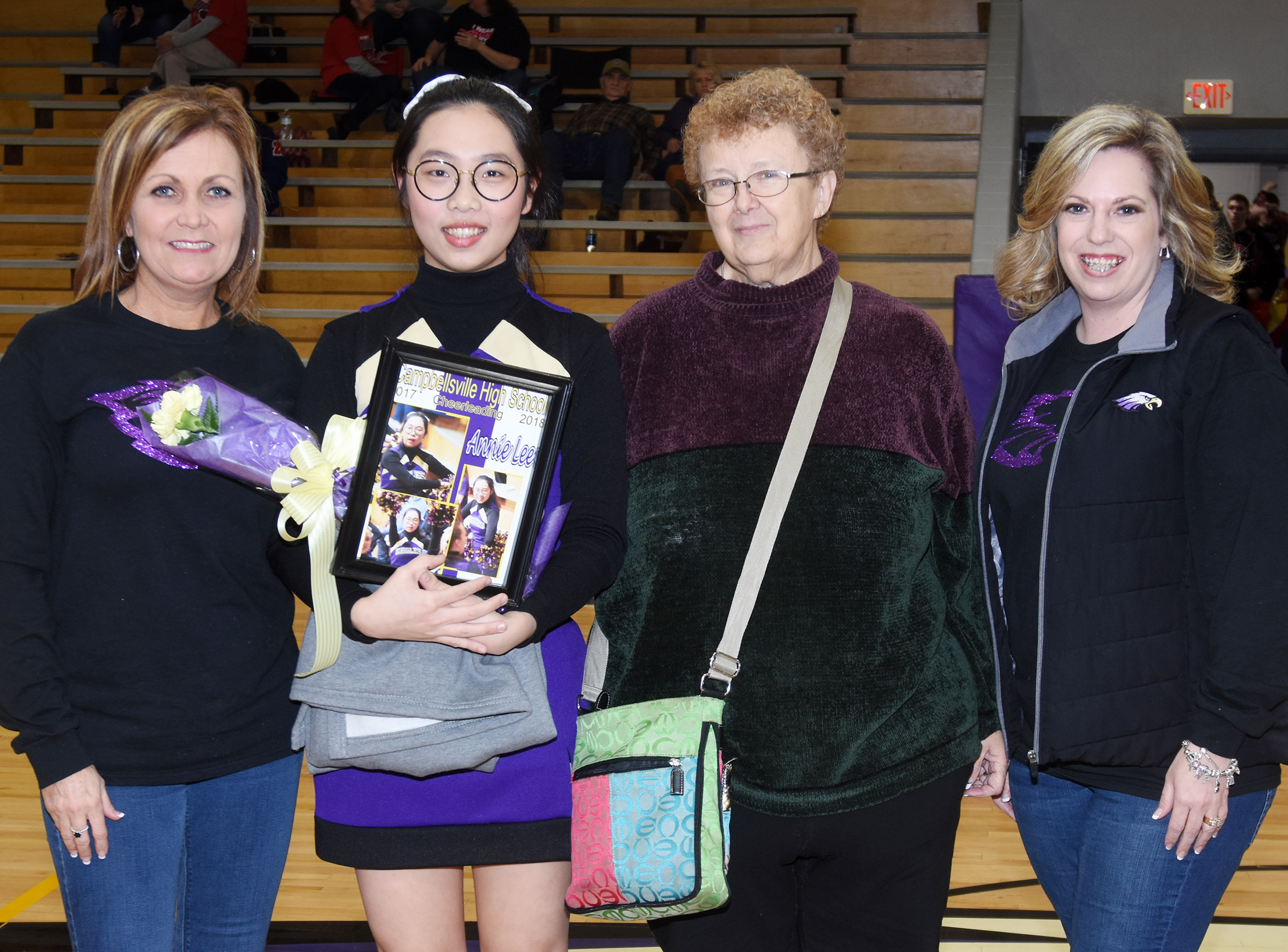 CHS cheerleader Annie Lee, an exchange student from Thailand, is honored. She is pictured with cheerleading coaches Lisa Wiseman, at left, and Nikki Price, and her host mother, Kathleen Lesperance.