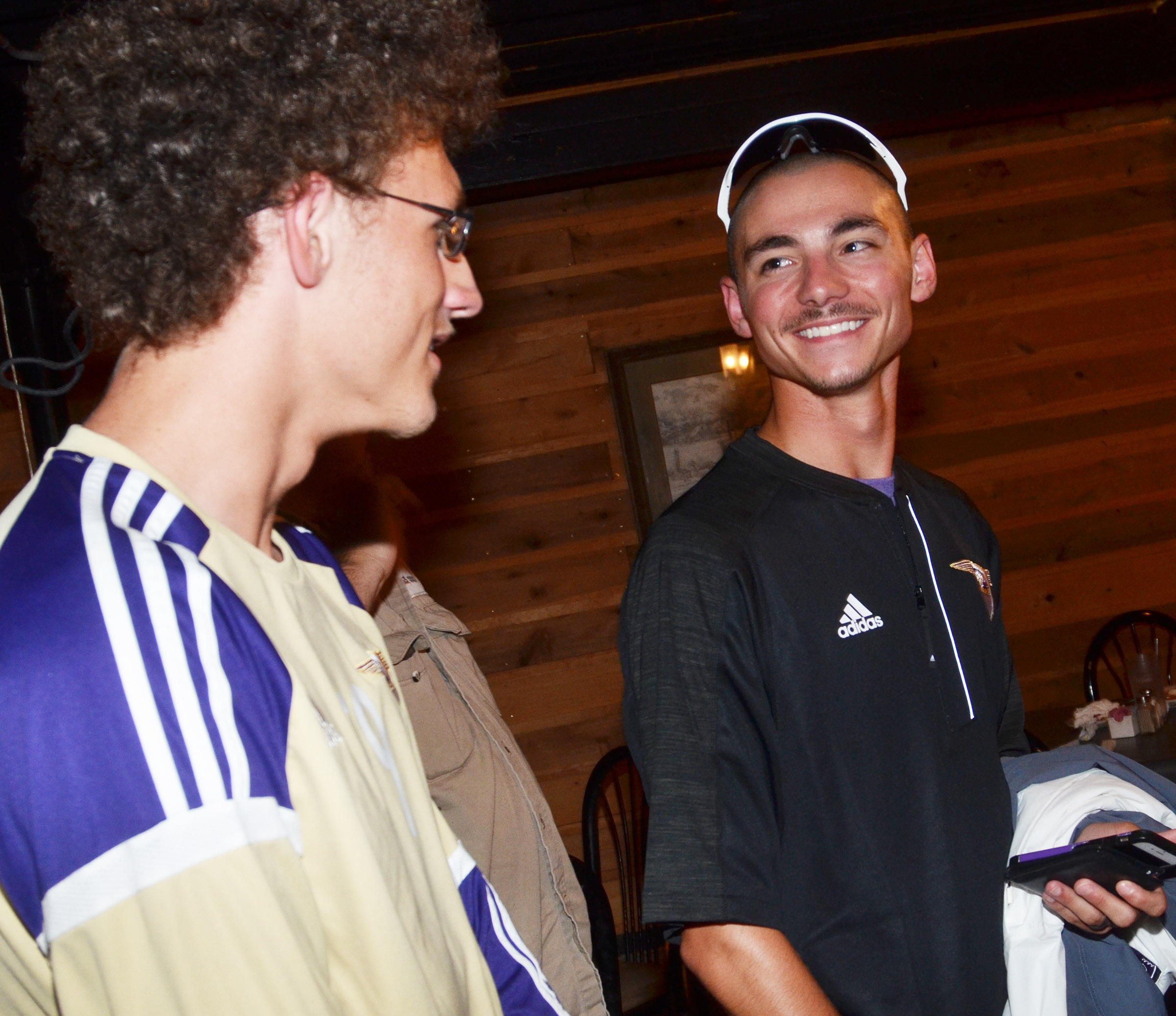 CHS head soccer coach Bradley Harris shares a laugh with sophomore Brennon Wheeler as the team celebrates at Creek Side Restaurant.