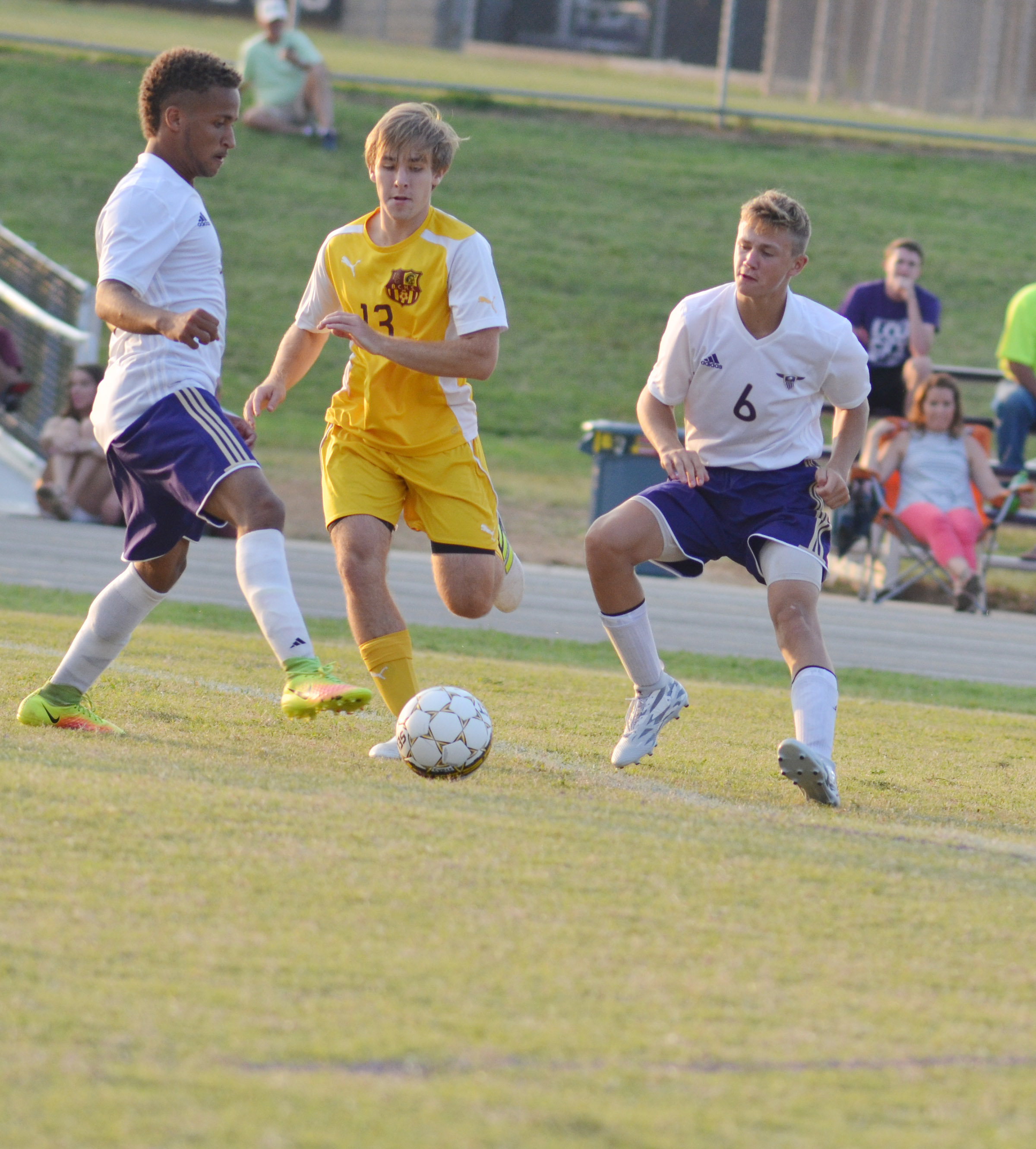 CHS senior Ethan Lay, at left, and freshman Blase Wheatley protect the ball.
