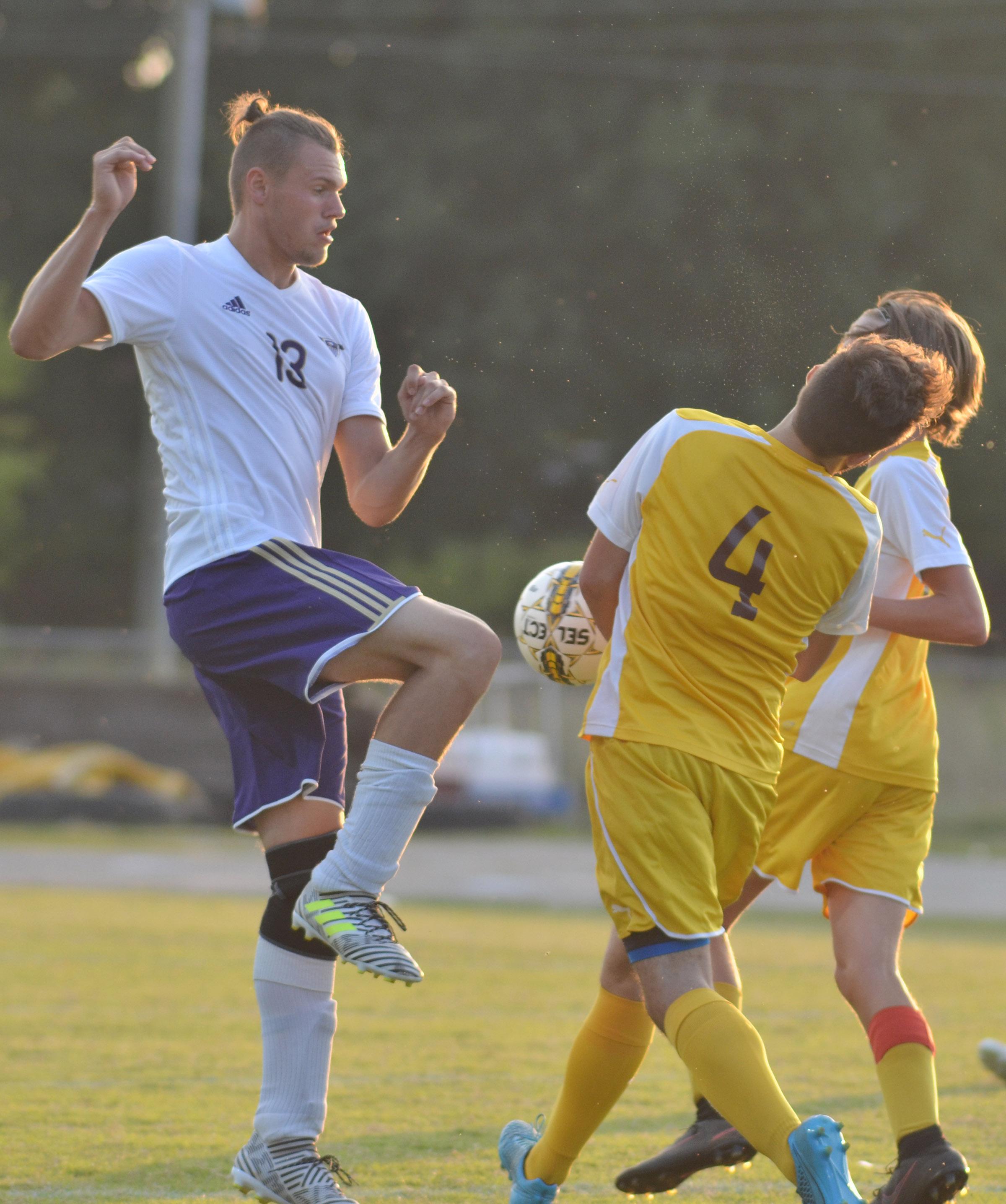 CHS senior Logan Cole kicks the ball.