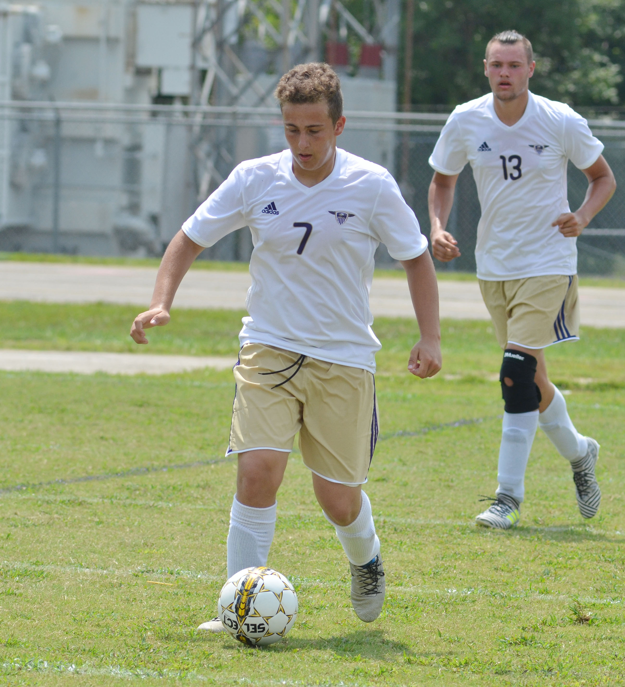 CHS junior Brody Weeks kicks the ball toward the goal.