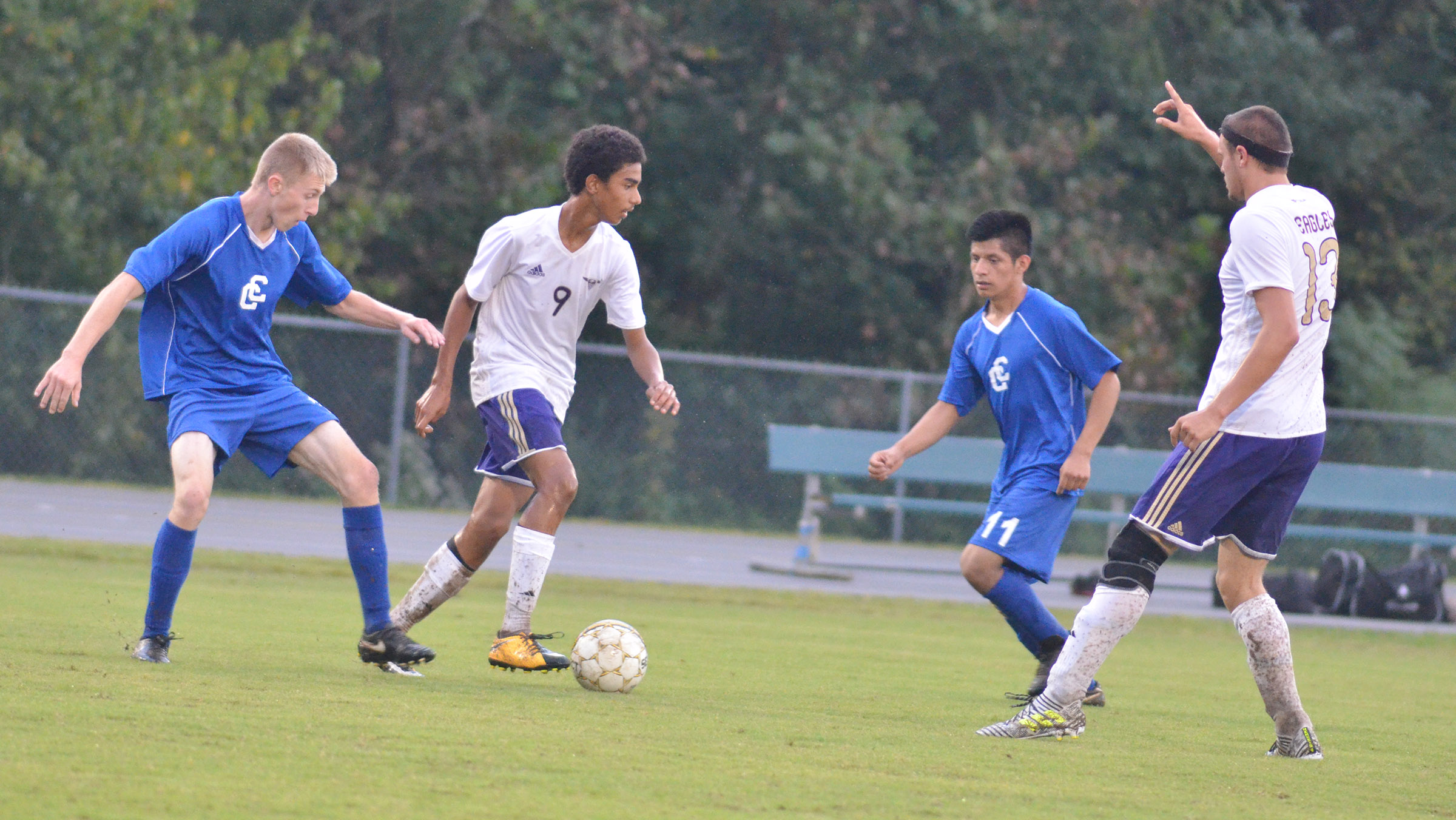 CHS sophomore David Silva, at left, and senior Logan Cole protect the ball.