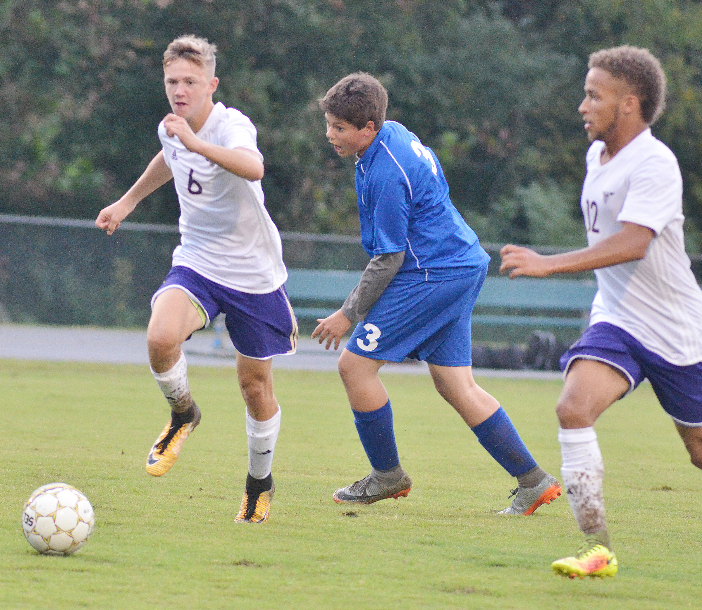 CHS freshman Blase Wheatley, at left, and senior Ethan Lay run to the ball.