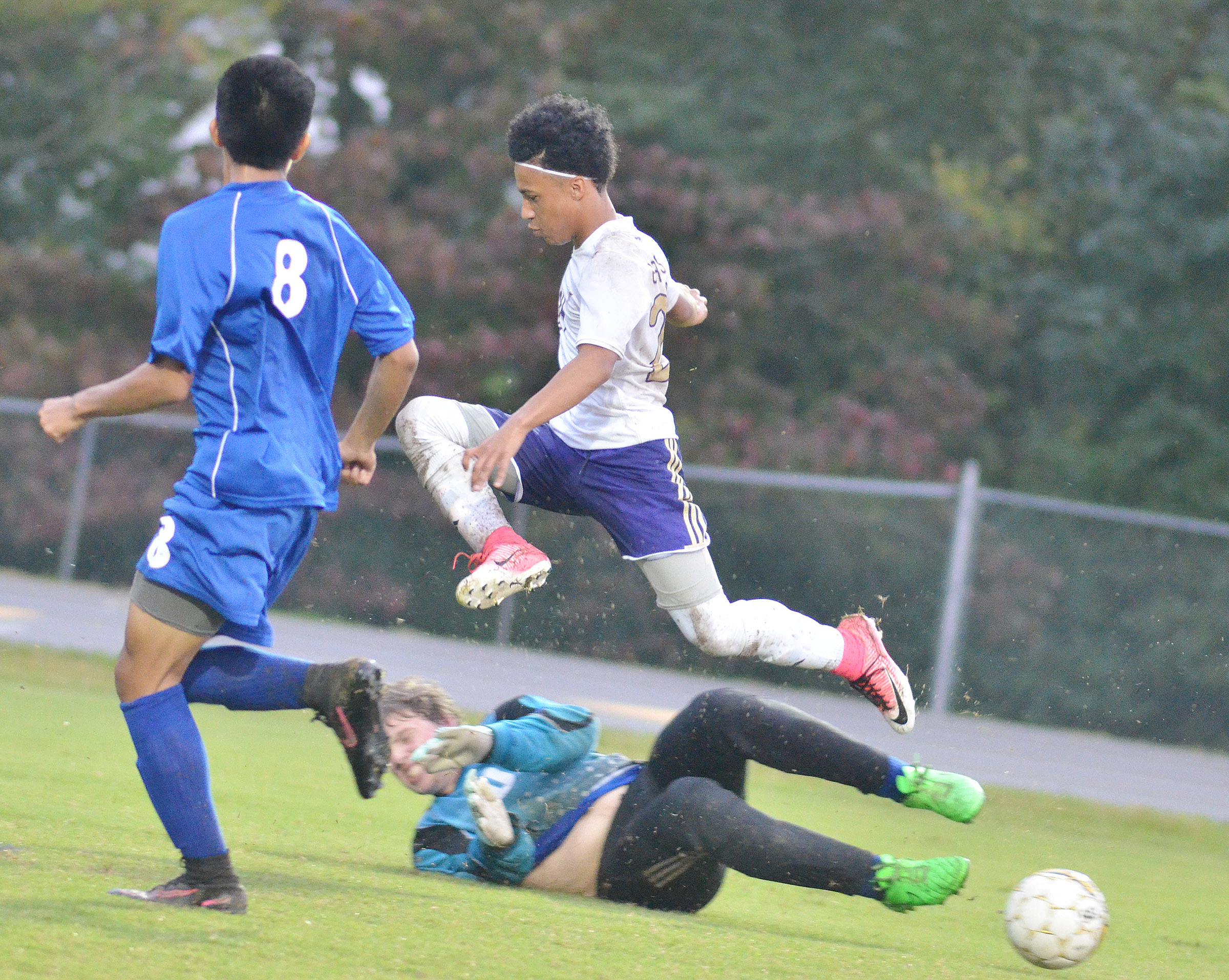CHS junior Daniel Johnson jumps for the ball.