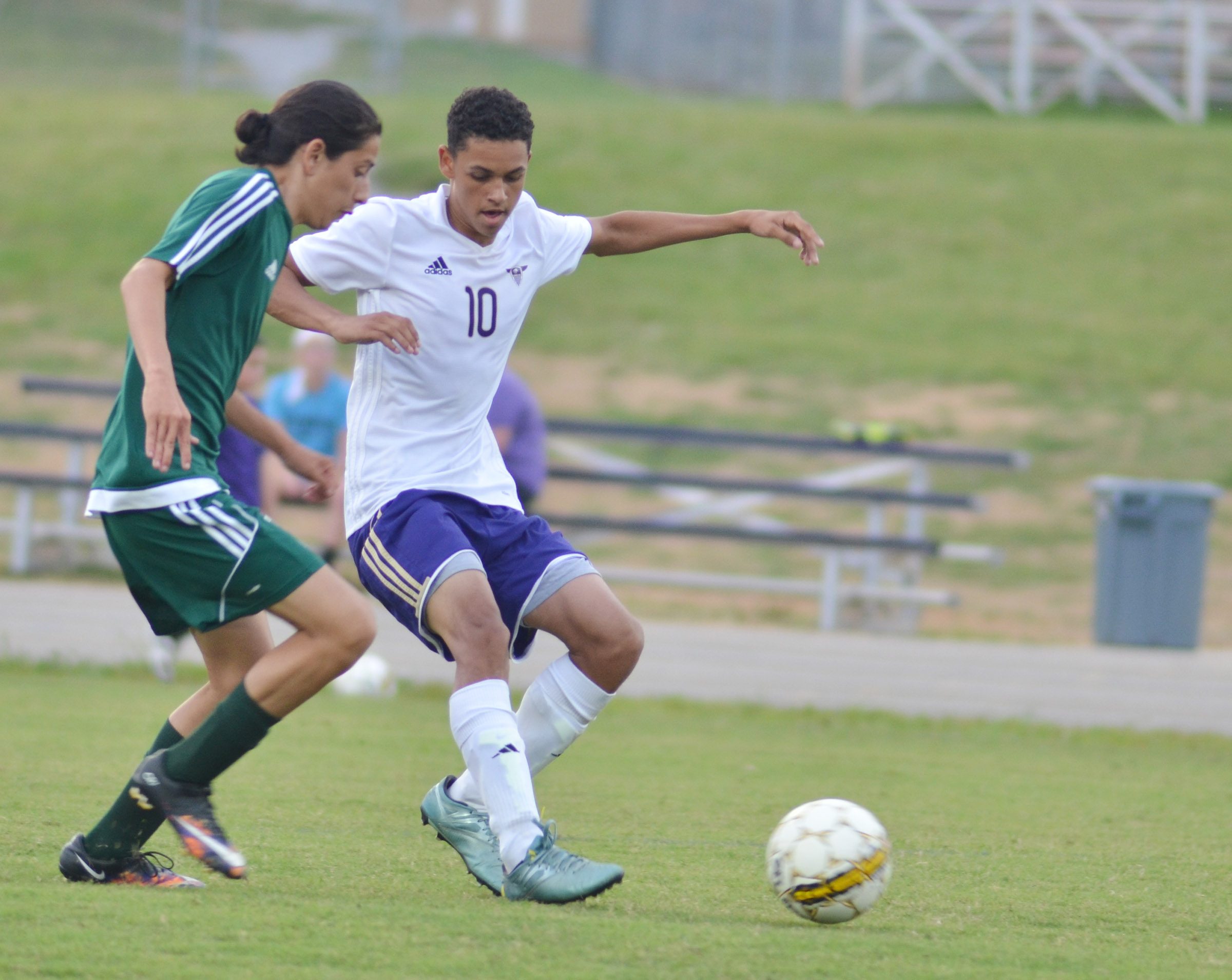 CHS sophomore Mikael Vaught kicks the ball.