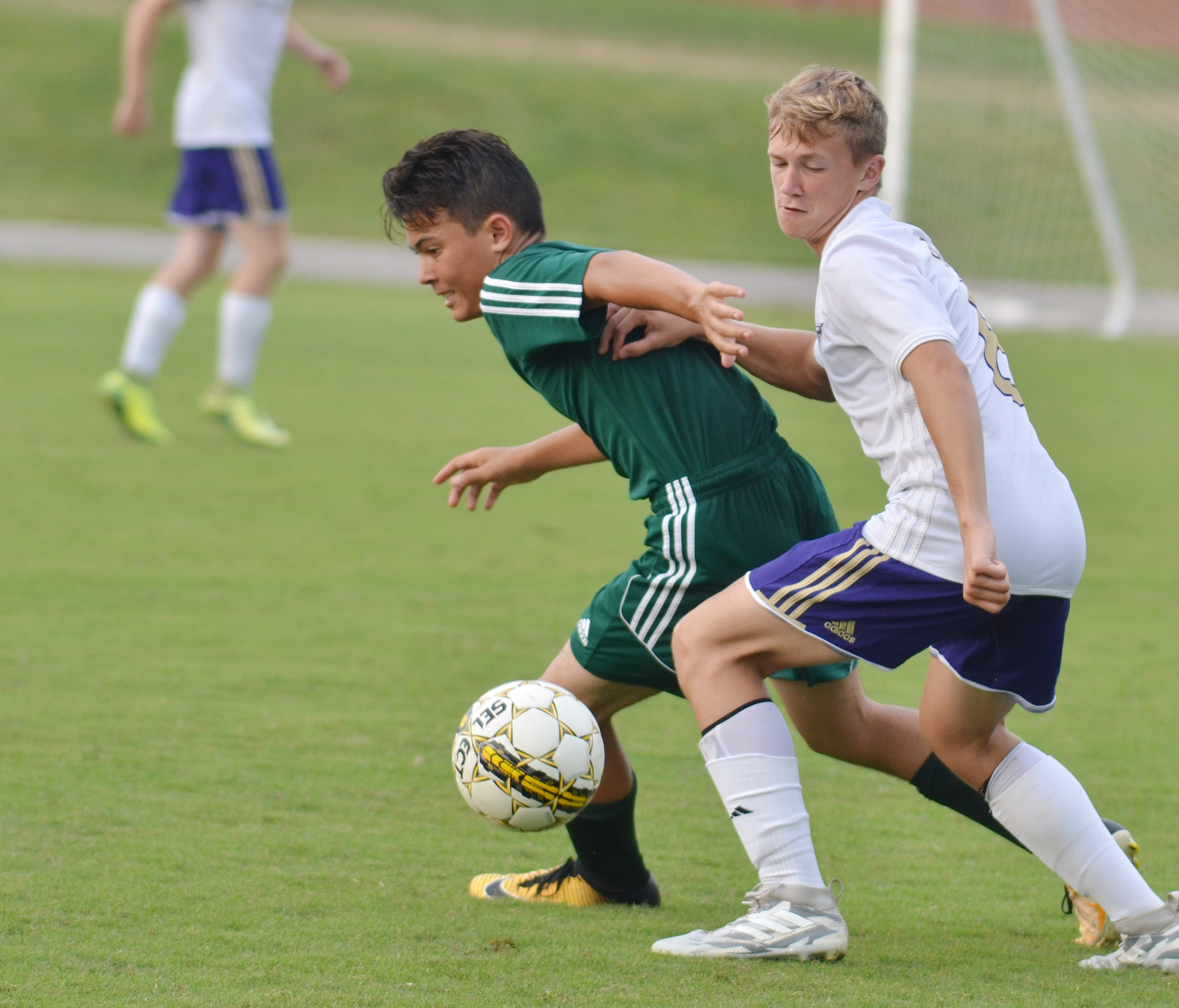 CHS freshman Blase Wheatley fights for control of the ball.