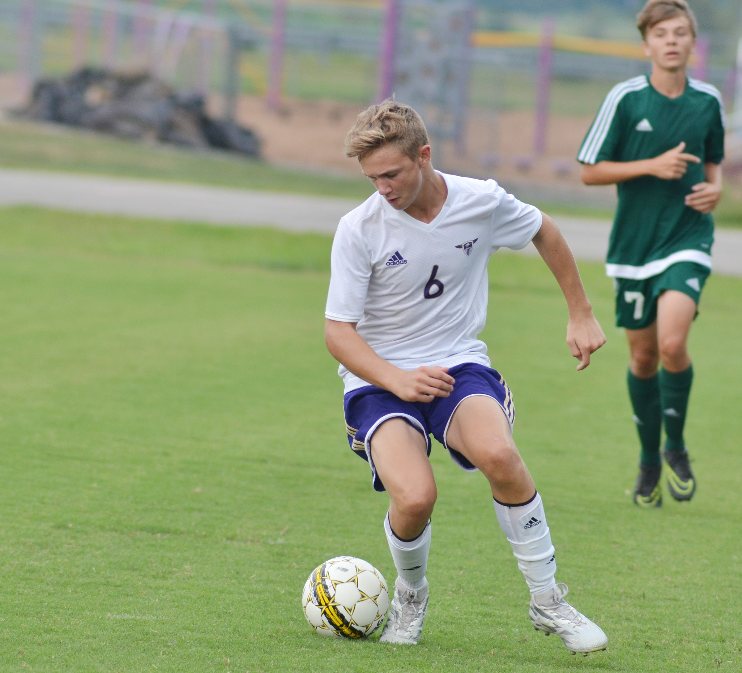 CHS freshman Blase Wheatley kicks the ball.