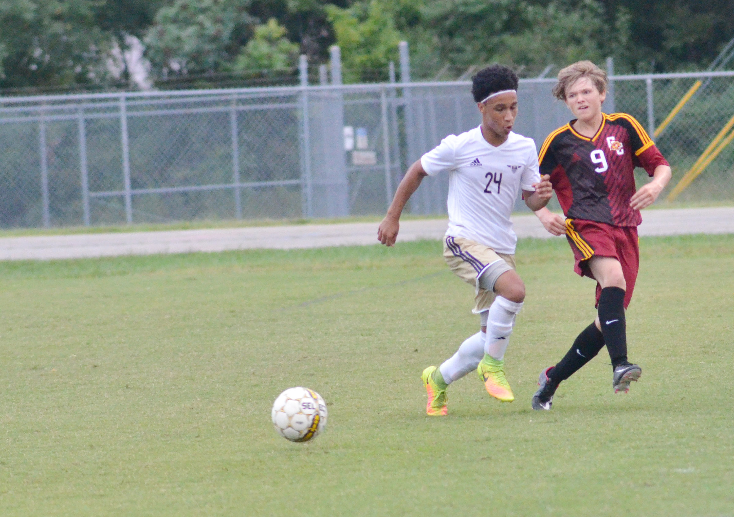 CHS junior Daniel Johnson fights for control of the ball.