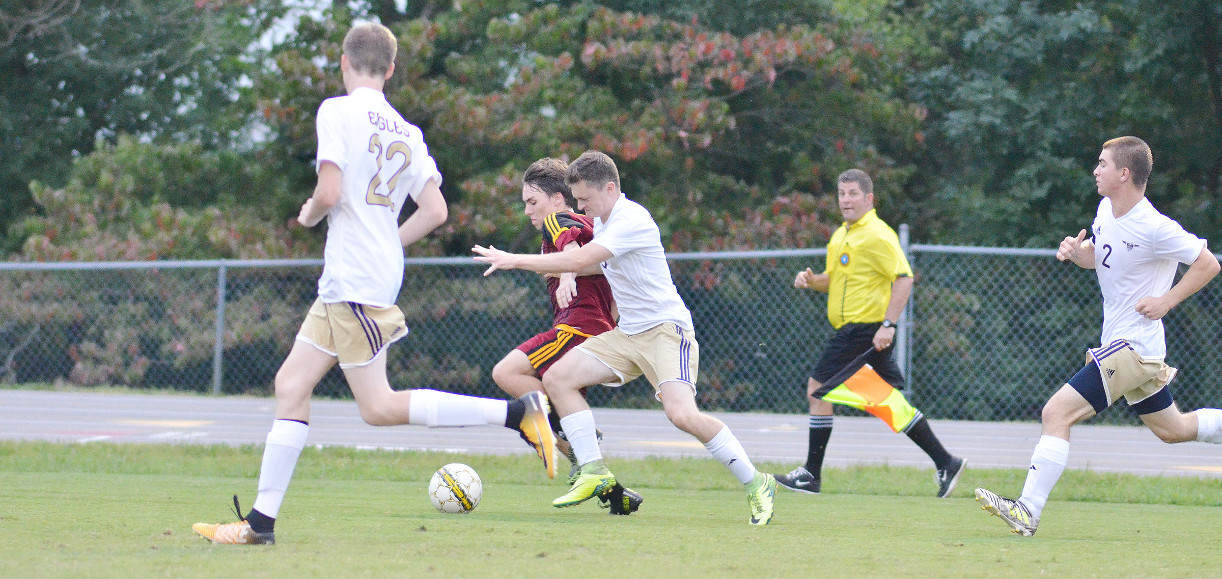 CHS senior Bryce Richardson, center, fights for the ball.