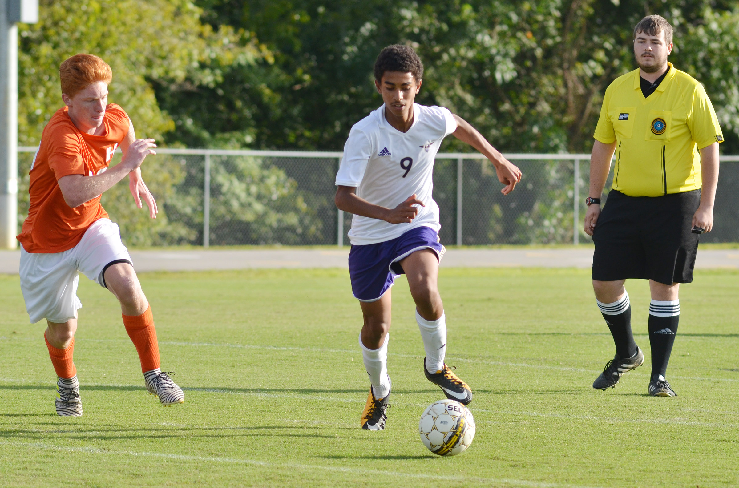 CHS senior Daniel Silva runs the ball down field.