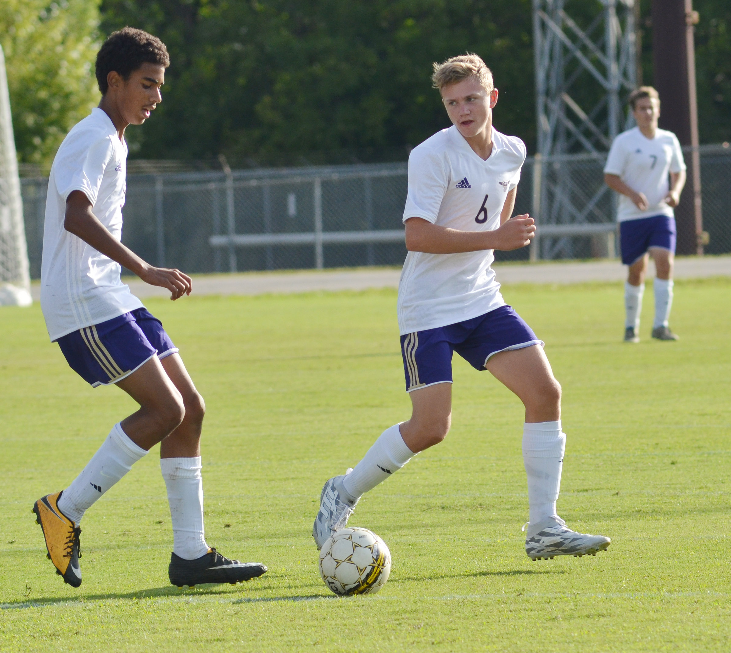 CHS sophomore Daniel Silva, at left, passes to freshman Blase Wheatley.
