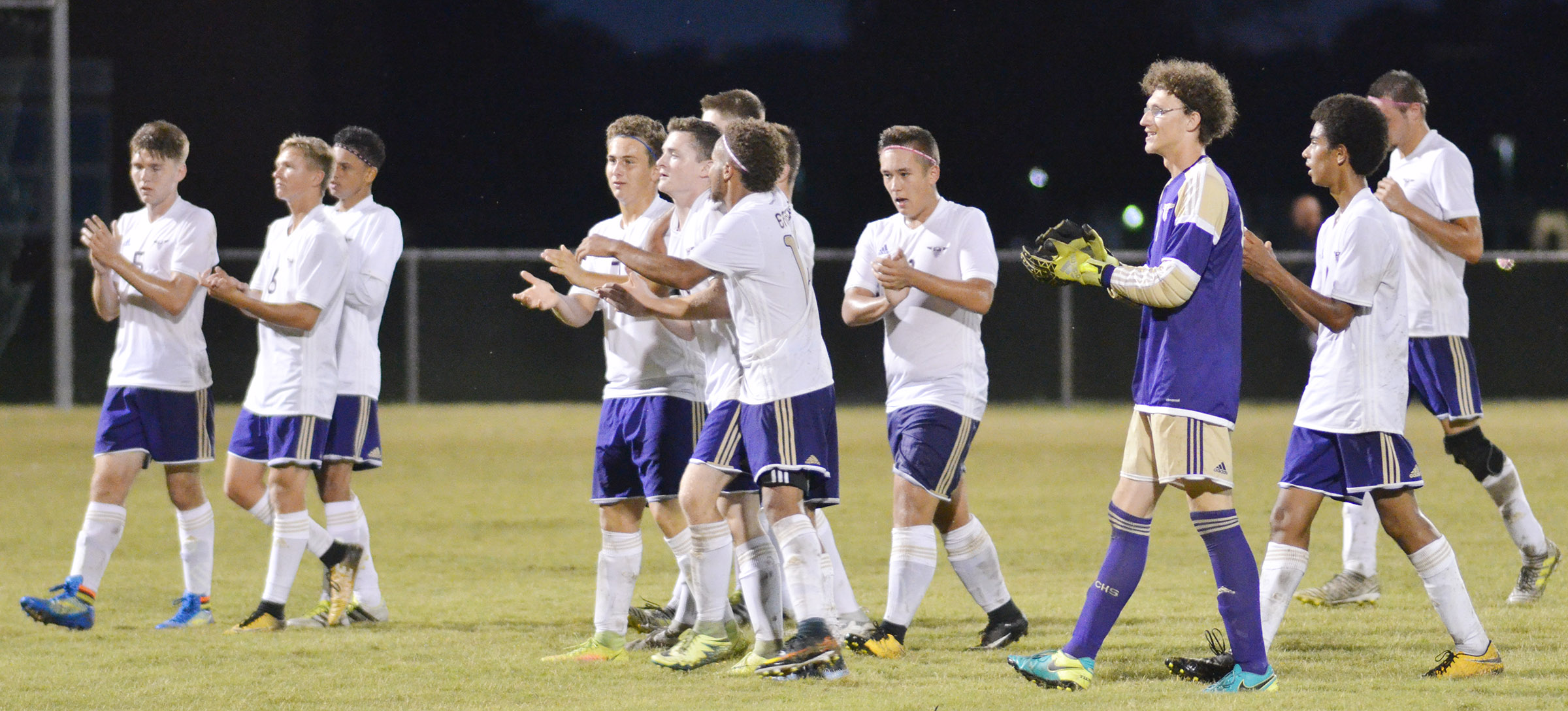CHS soccer players celebrate their win.