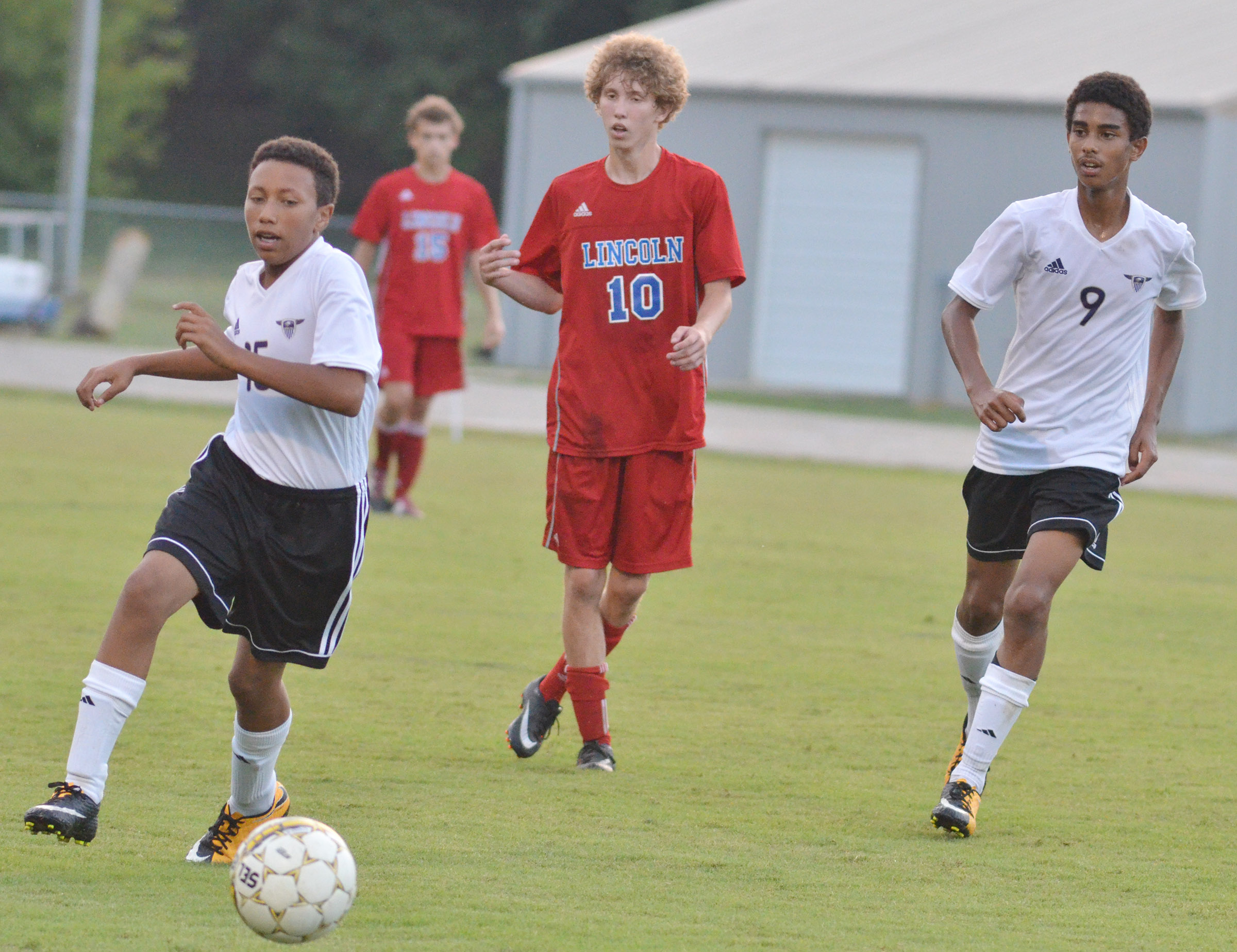 CHS freshman Jastyn Shively, at left, and sophomore David Silva run to the ball.