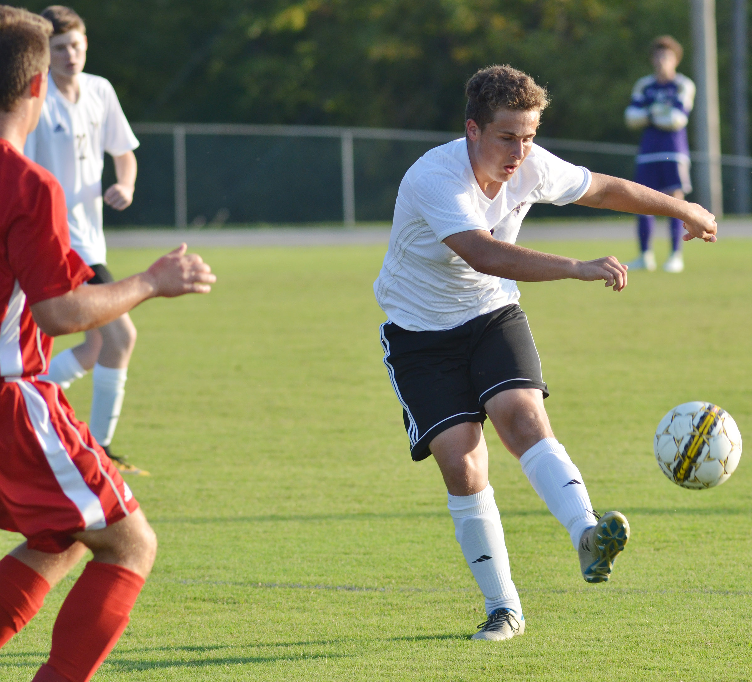 CHS junior Brody Weeks kicks the ball.