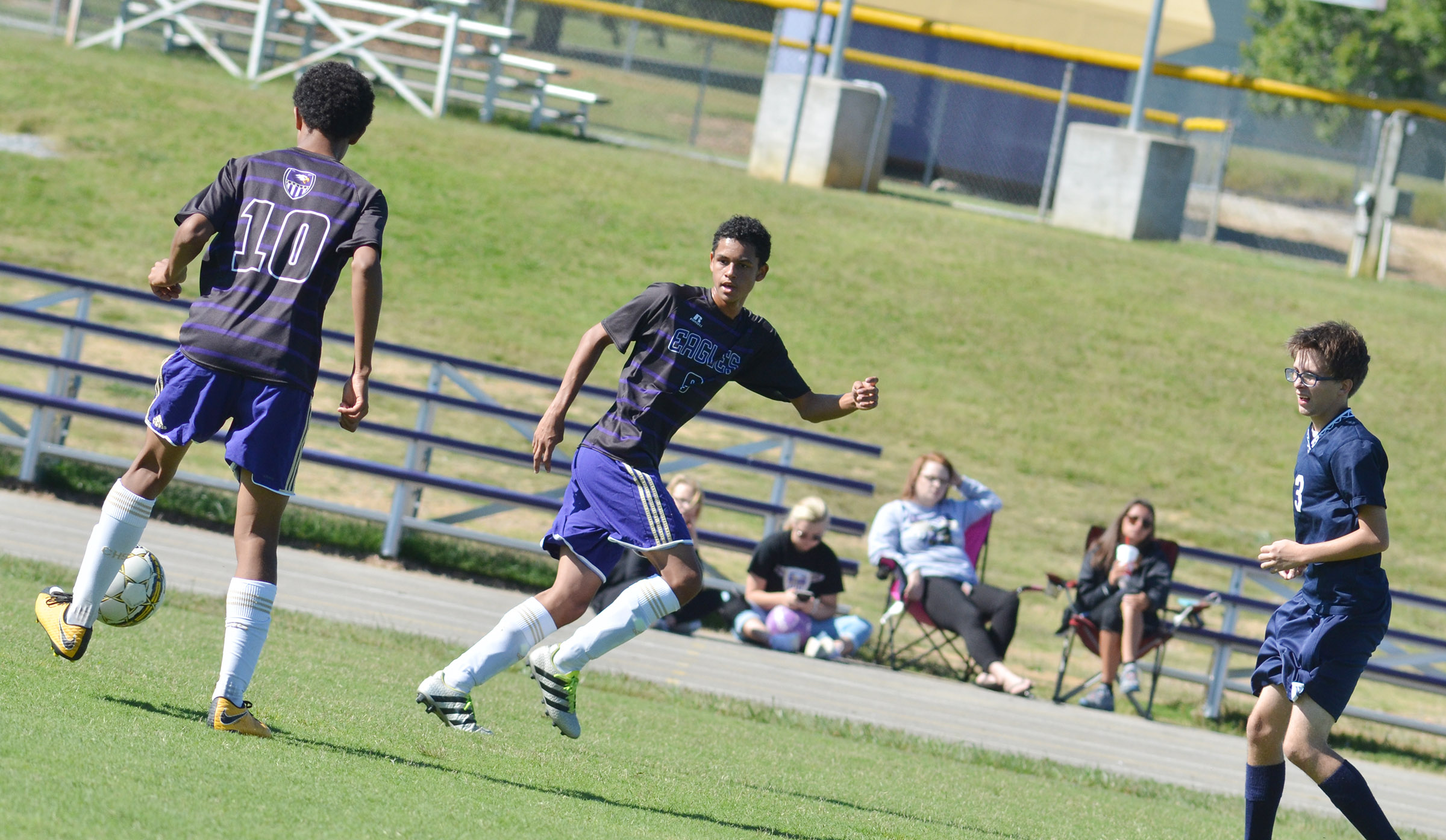 CHS sophomore David Silva, at left, passes the ball to classmate Mikael Vaught.