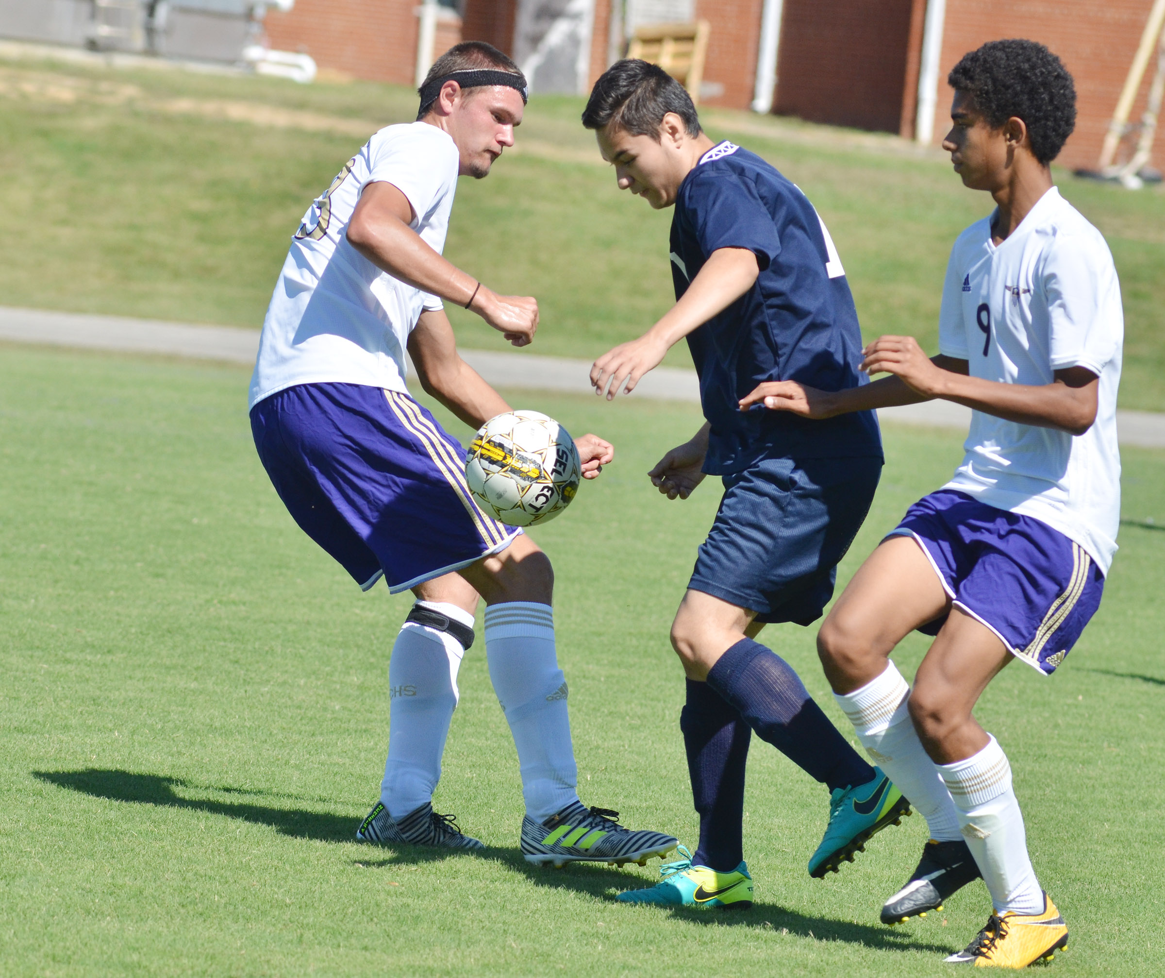 CHS senior Logan Cole, at left, and sophomore David Silva play defense.