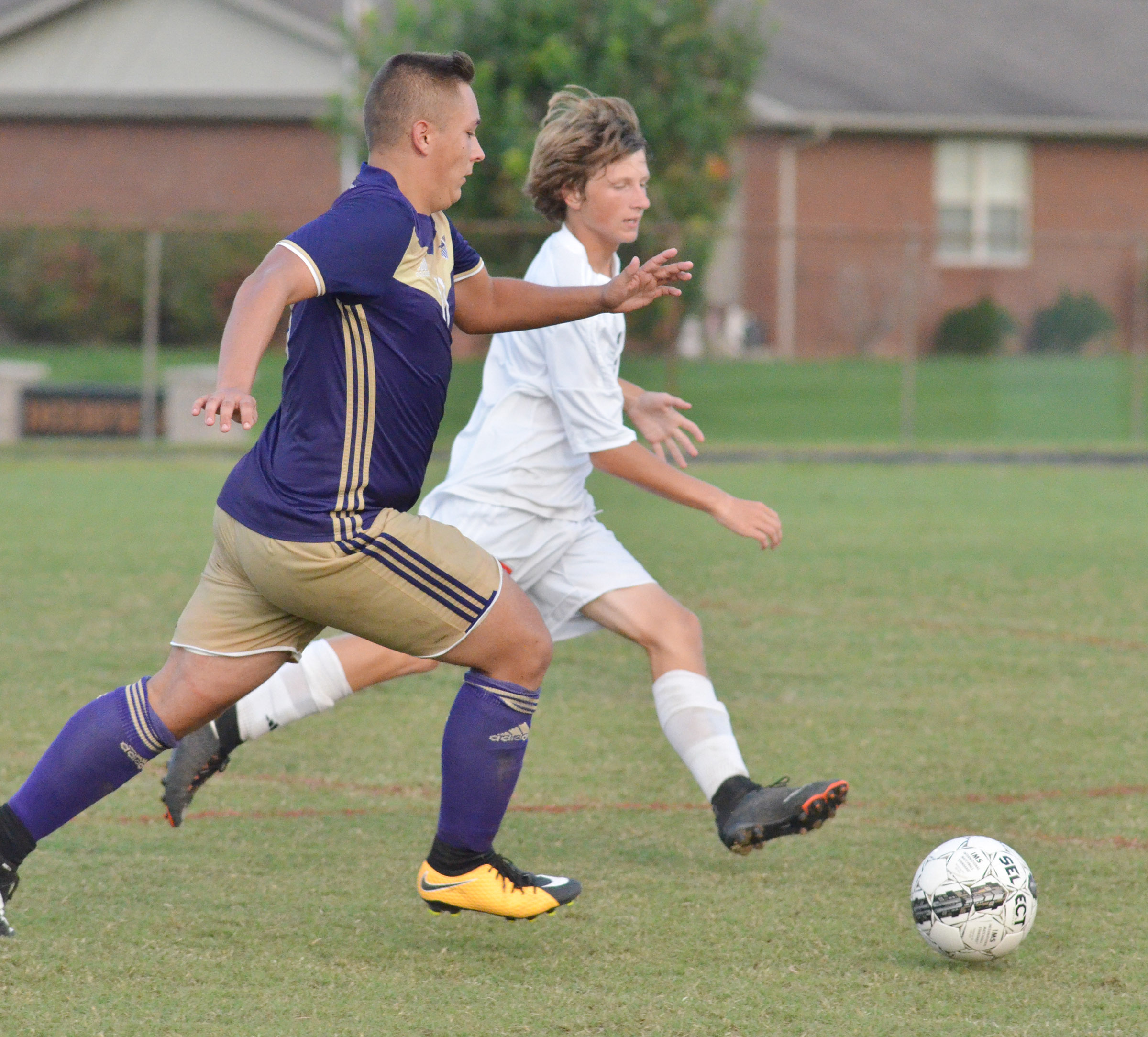 CHS senior Cody Davis kicks the ball.
