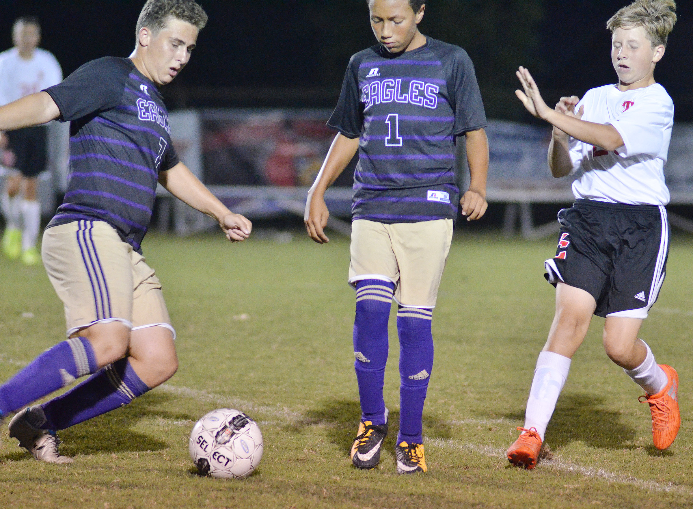 CHS junior Brody Weeks, at left, and freshman Jastyn Shively protect the ball.