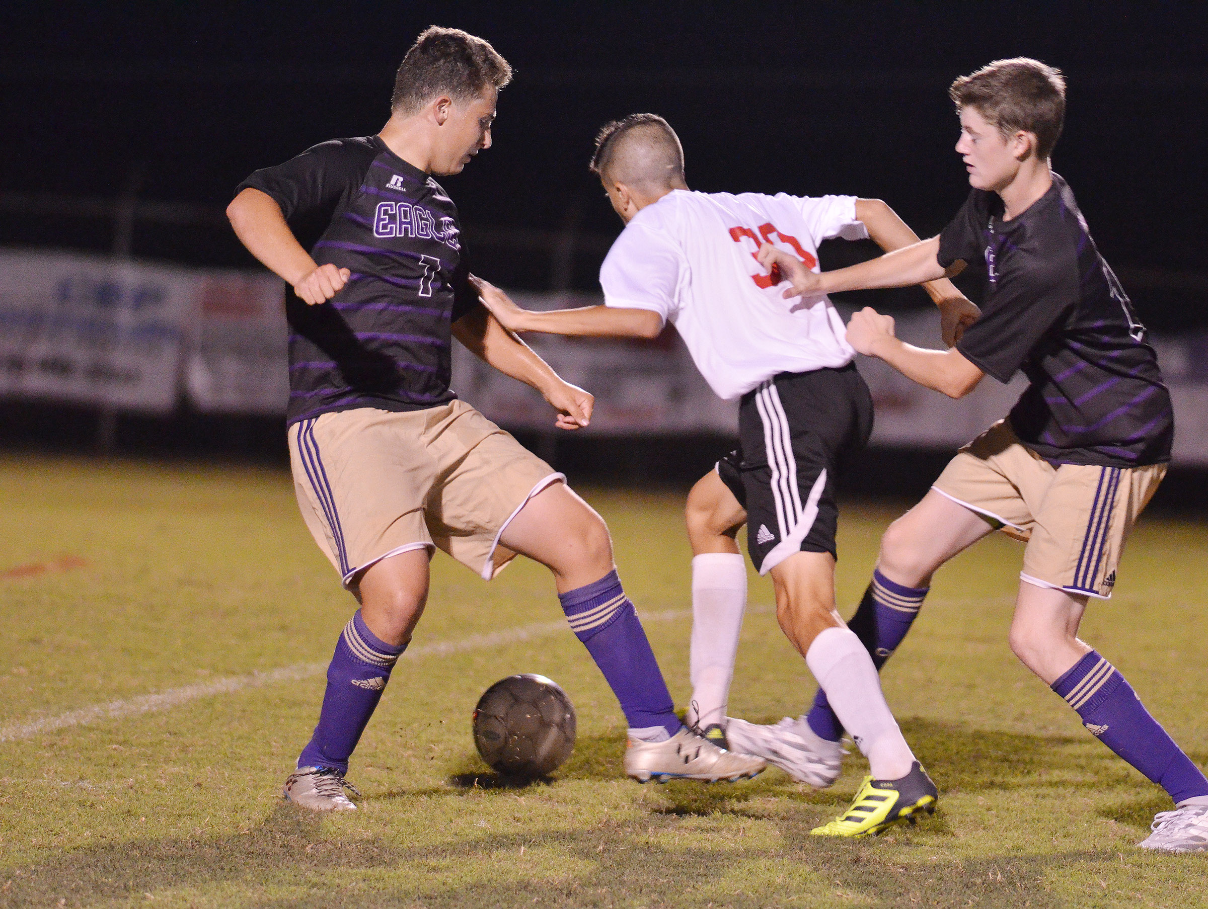 CHS junior Blase Wheatley, at left, and freshman Tristin Faulkner battle for the ball.