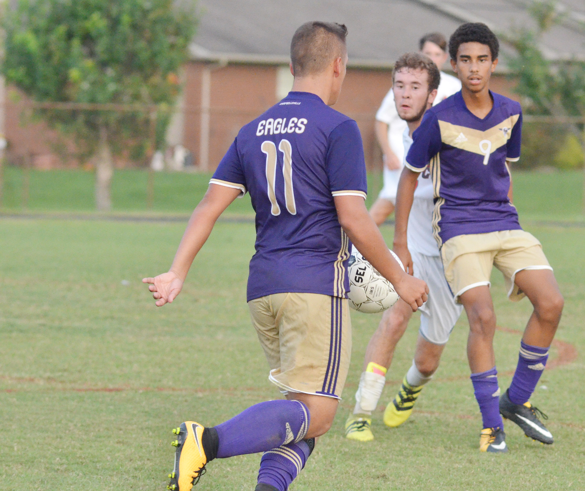 CHS senior Cody Davis passes the ball to sophomore David Silva.
