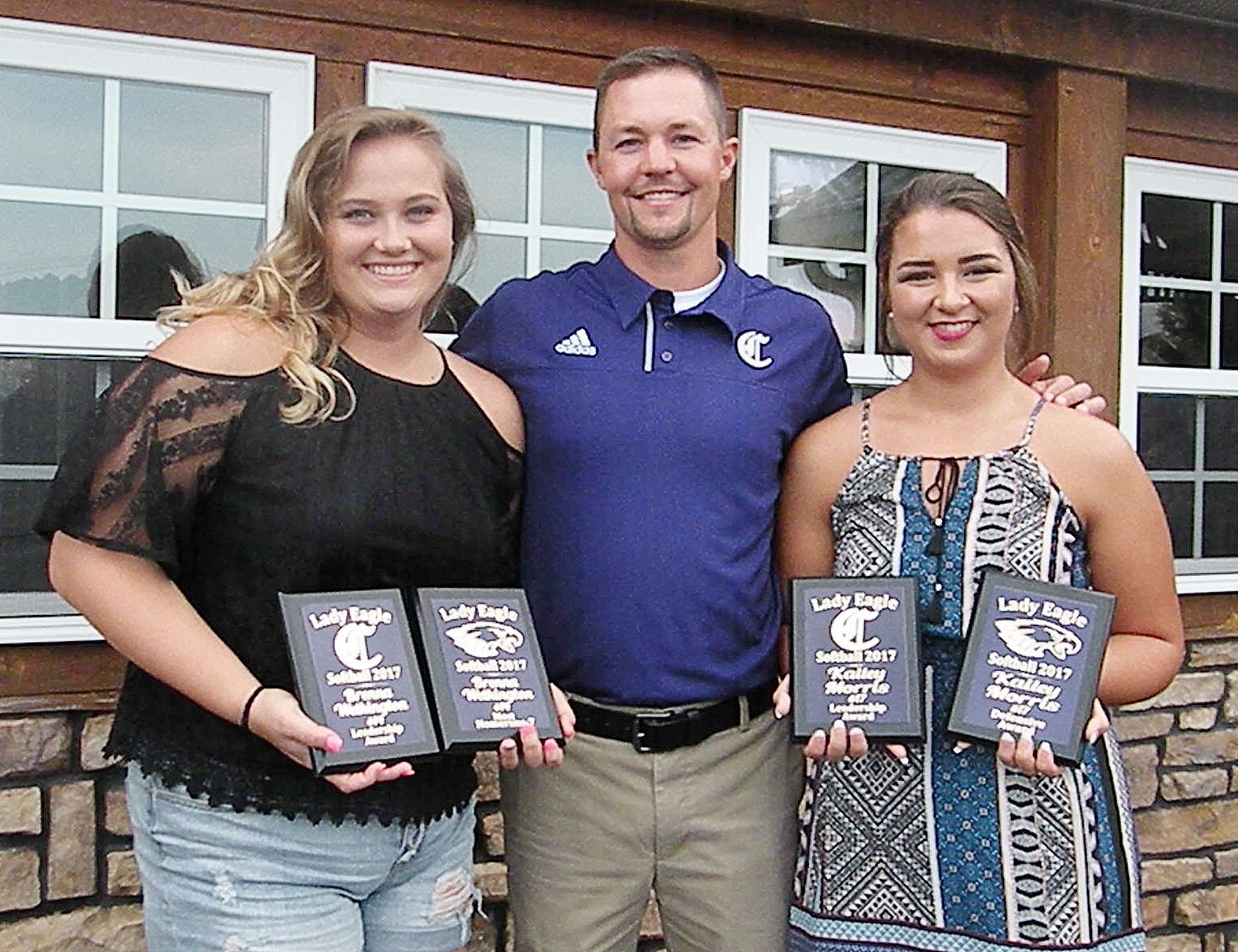 Brenna Wethington, at left, and Kailey Morris, who graduated from CHS in May, were honored for their dedication to their team. Wethington received the Most Home Runs Award and Morris received the Defense Award. The two, pictured with head coach Weston Jones, also each received the Leadership Award.