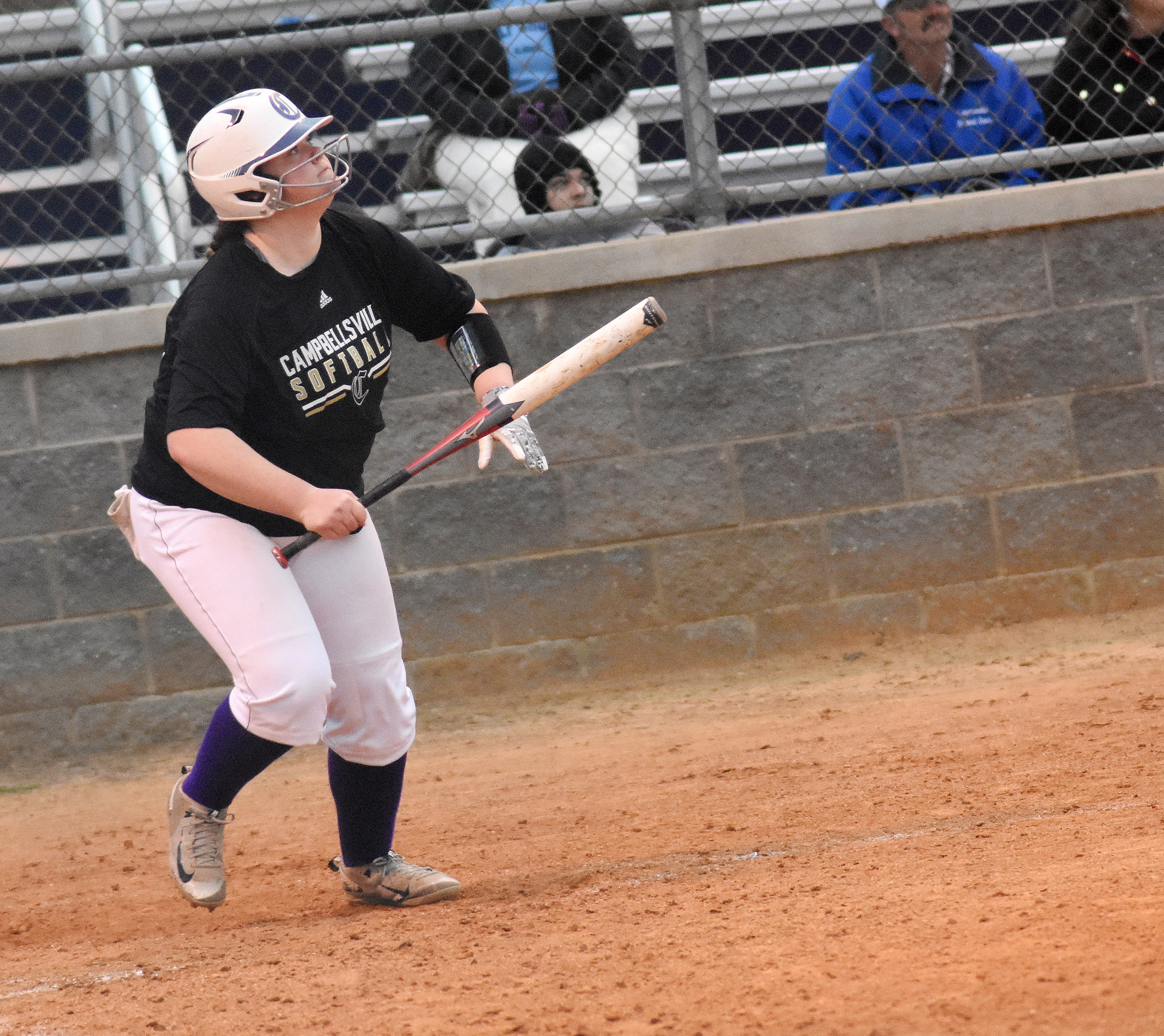 CHS sophomore Shallan Philpott watches as the ball she hit goes over the fence.