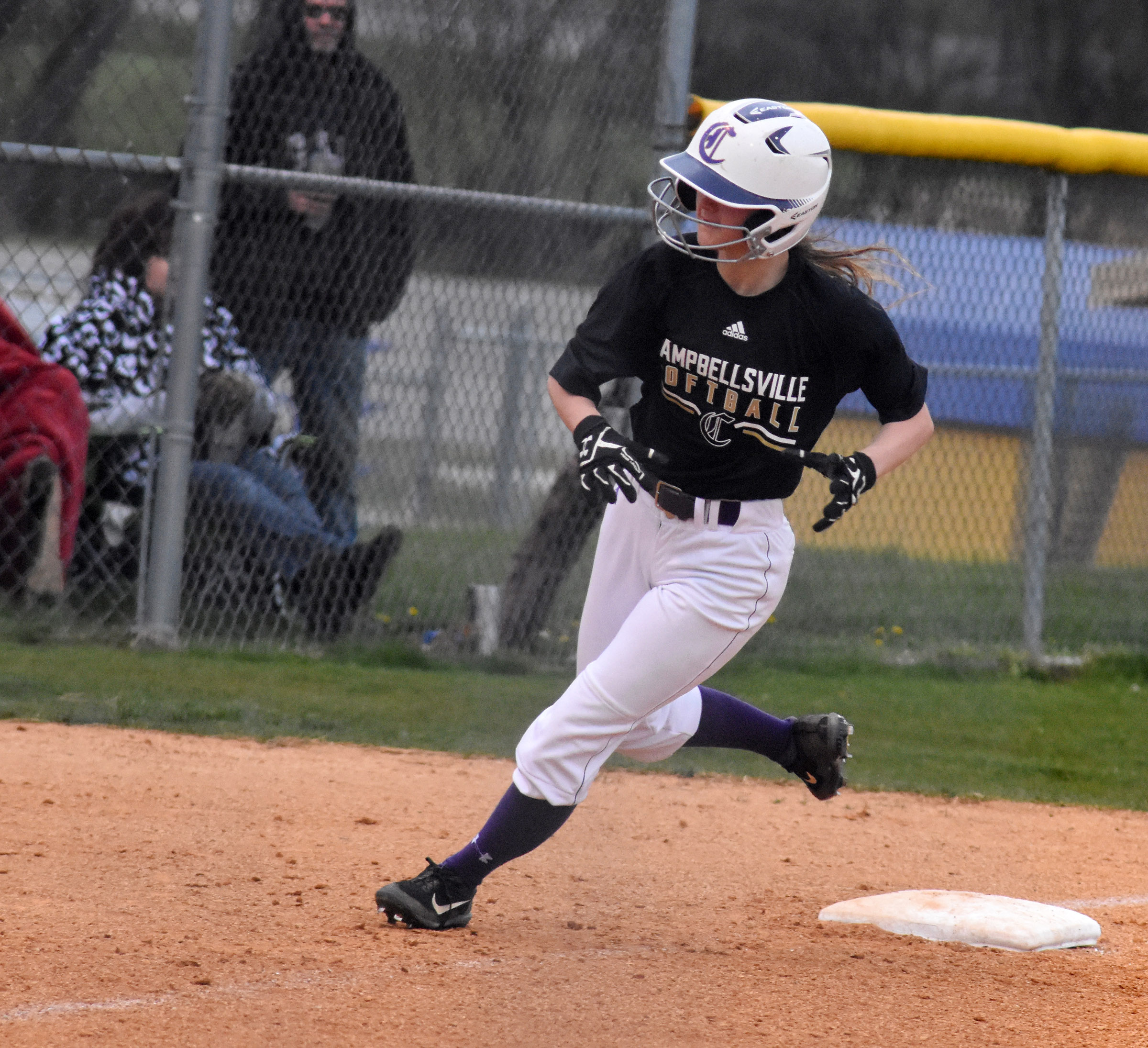 CHS sophomore Bailey Thompson rounds third to run home.