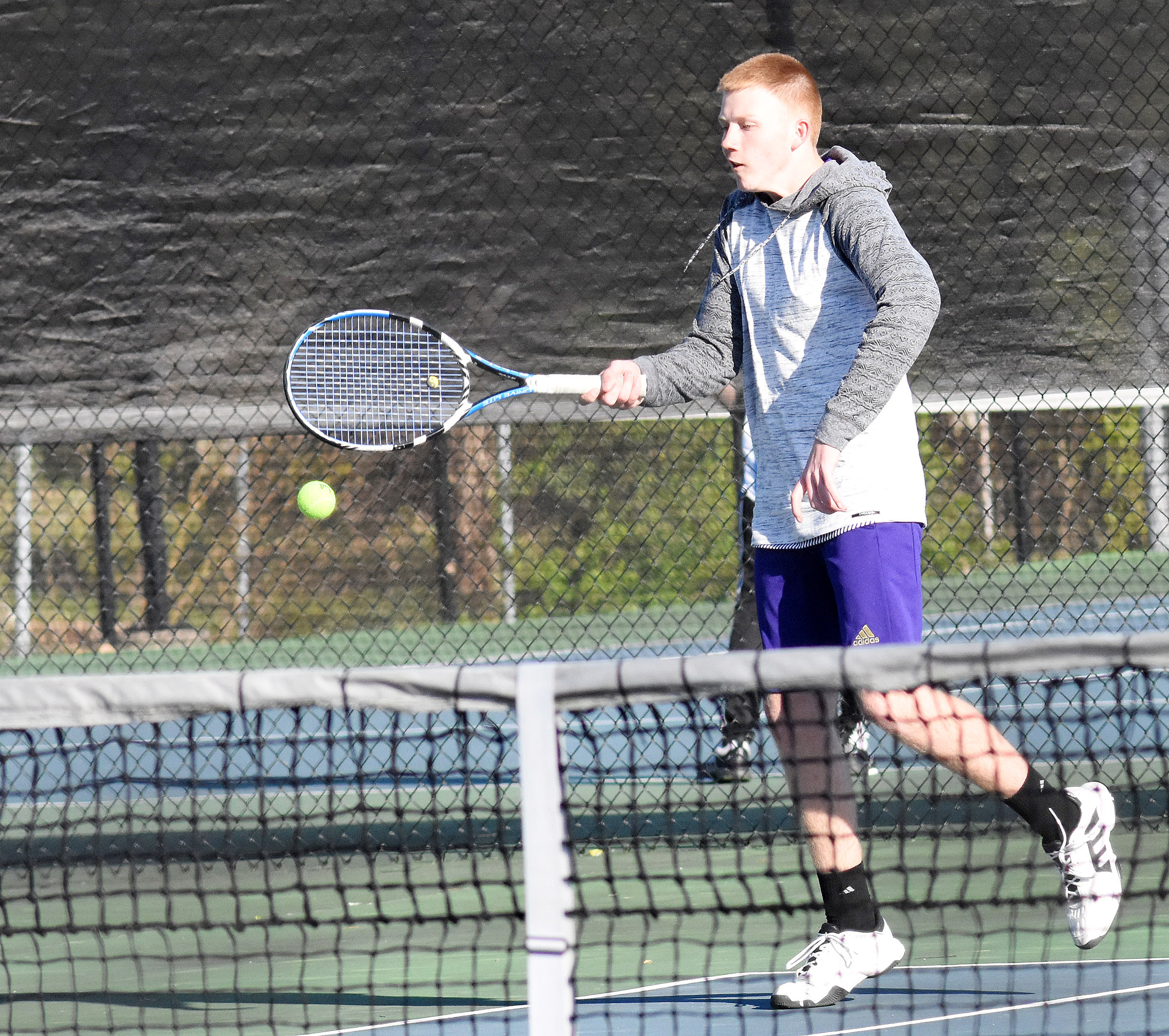 CHS sophomore Patrick Walker returns a serve.