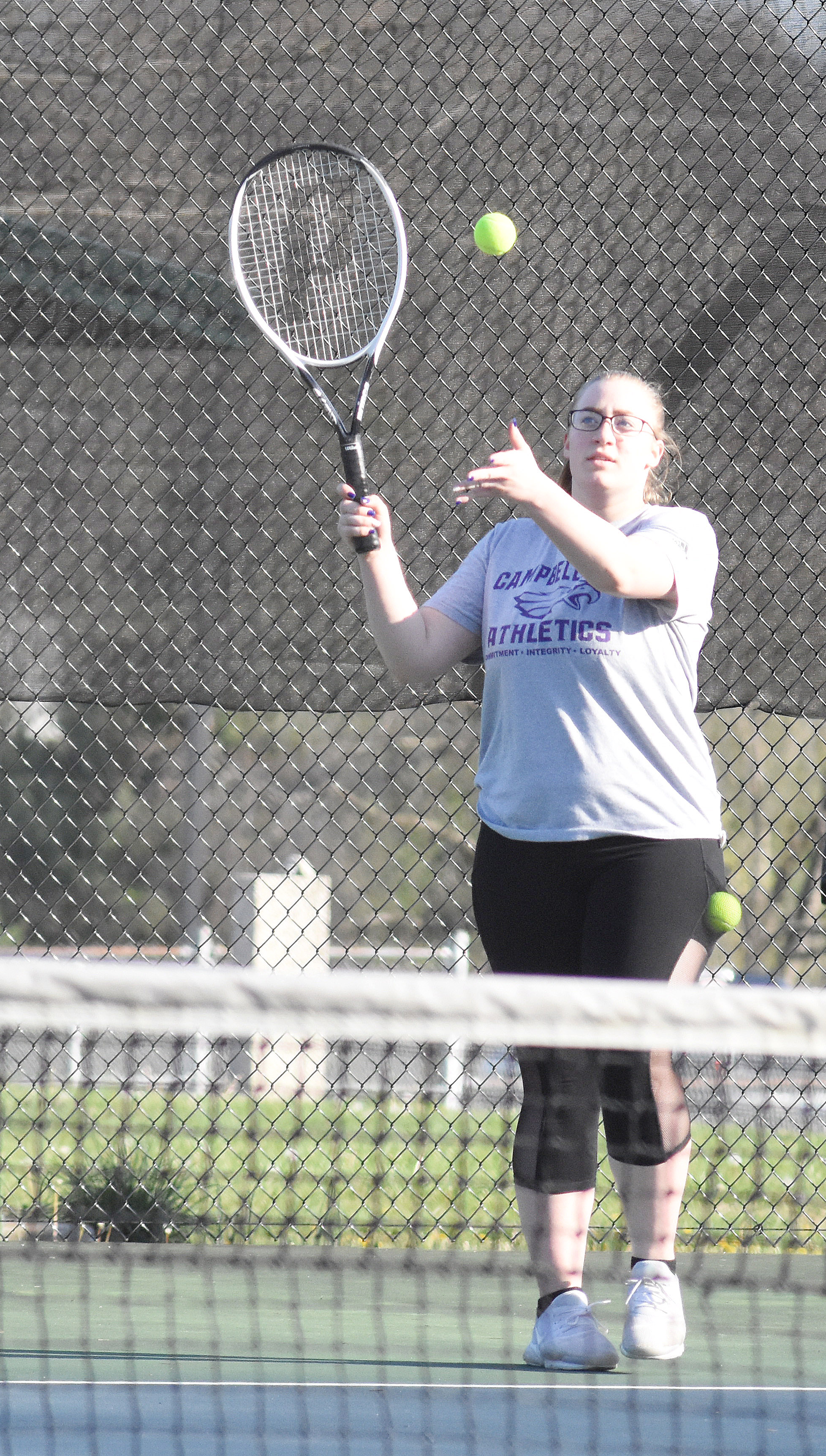 CHS sophomore Samantha Johnson serves.