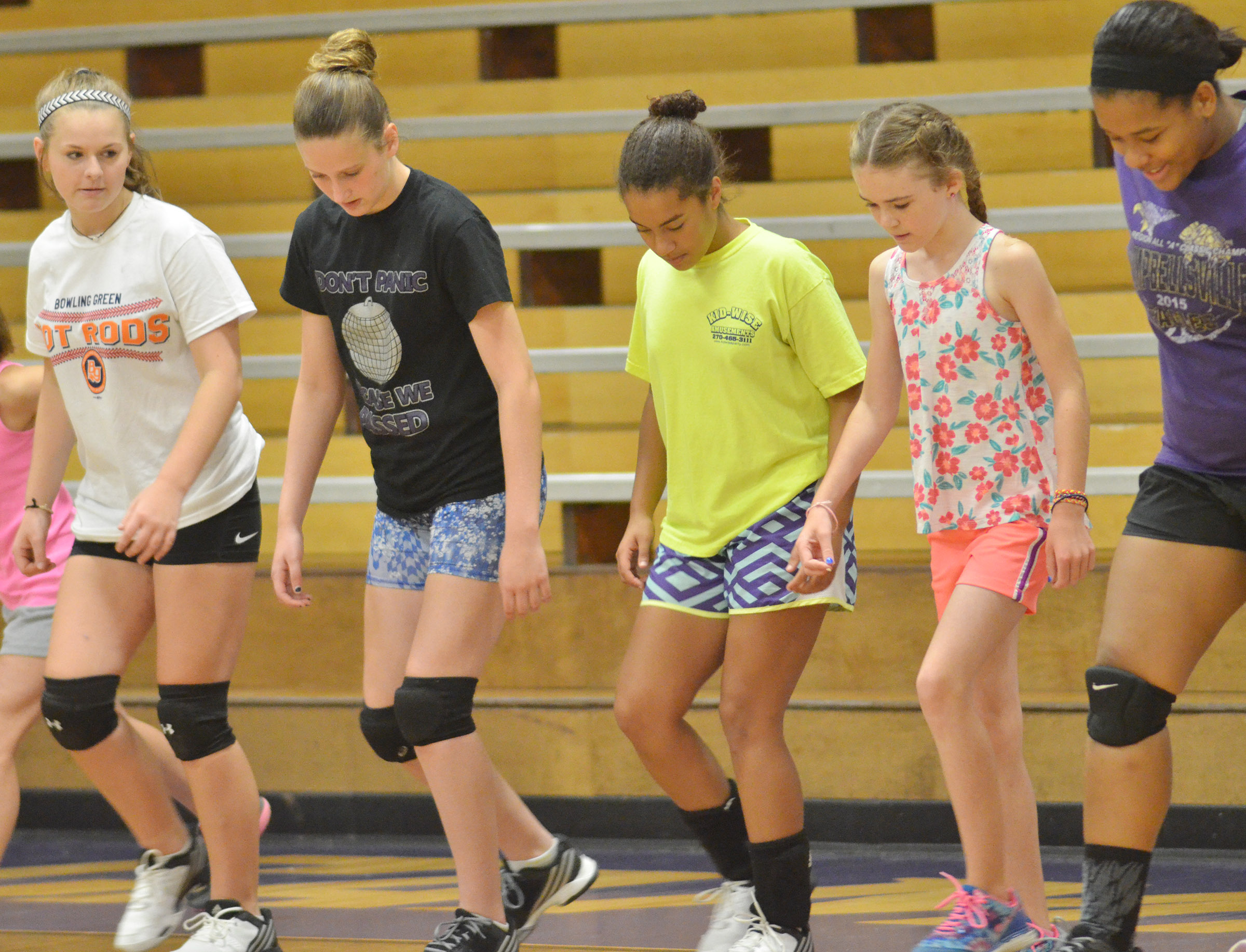 From left, CHS freshmen Taylor Knight, Zoie Sidebottom and Laci Hodgens, and senior Kayla Young, at right, help Alissa Hughes, a fourth-grader at Hodgenville Elementary School, run a warmup drill.
