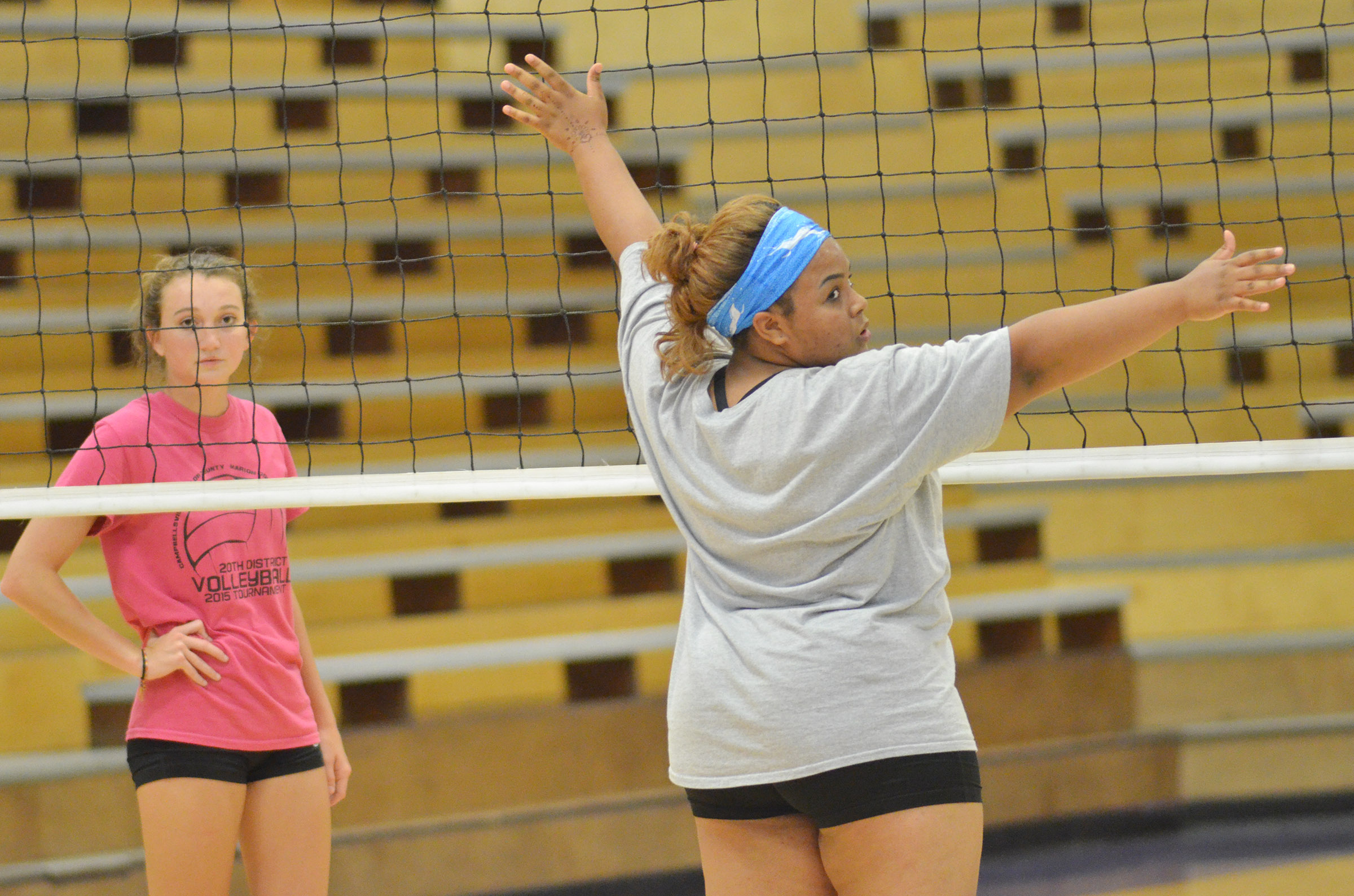 CHS juniors Salena Ritchie, at left, and Natalie Caldwell get ready for the serve.