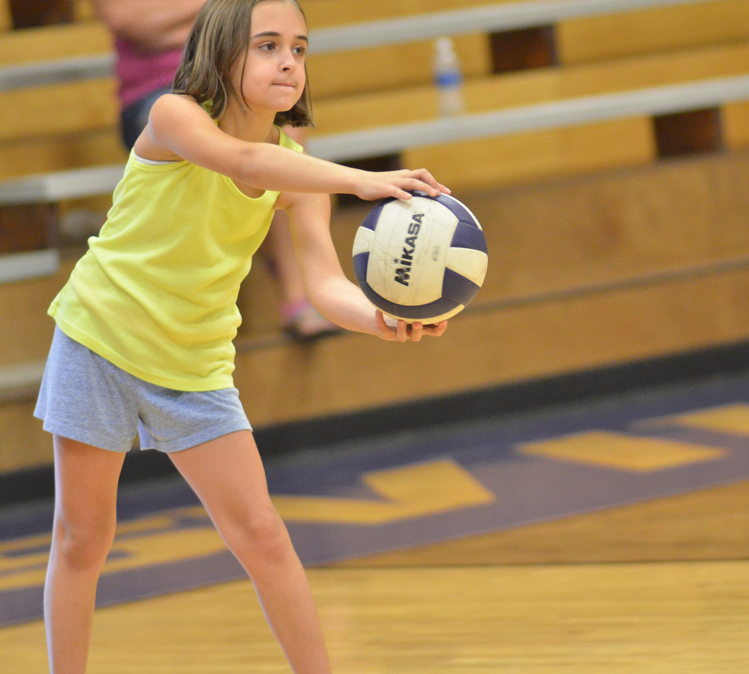 CES fifth-grader Anna Floyd practices serving.
