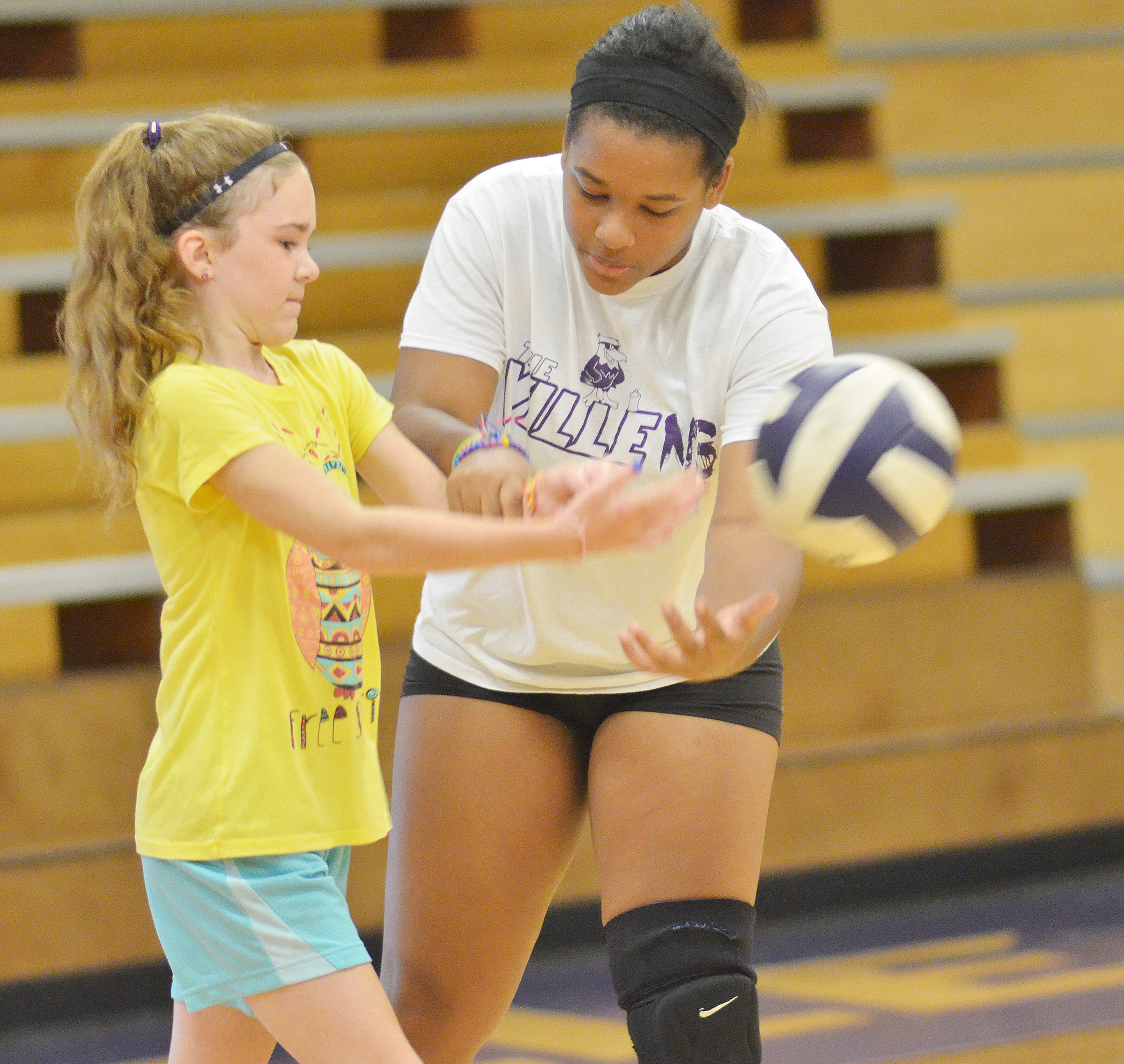 CHS senior Kayla Young helps Alissa Hughes, a fourth-grader at Hodgenville Elementary School, learn to serve.