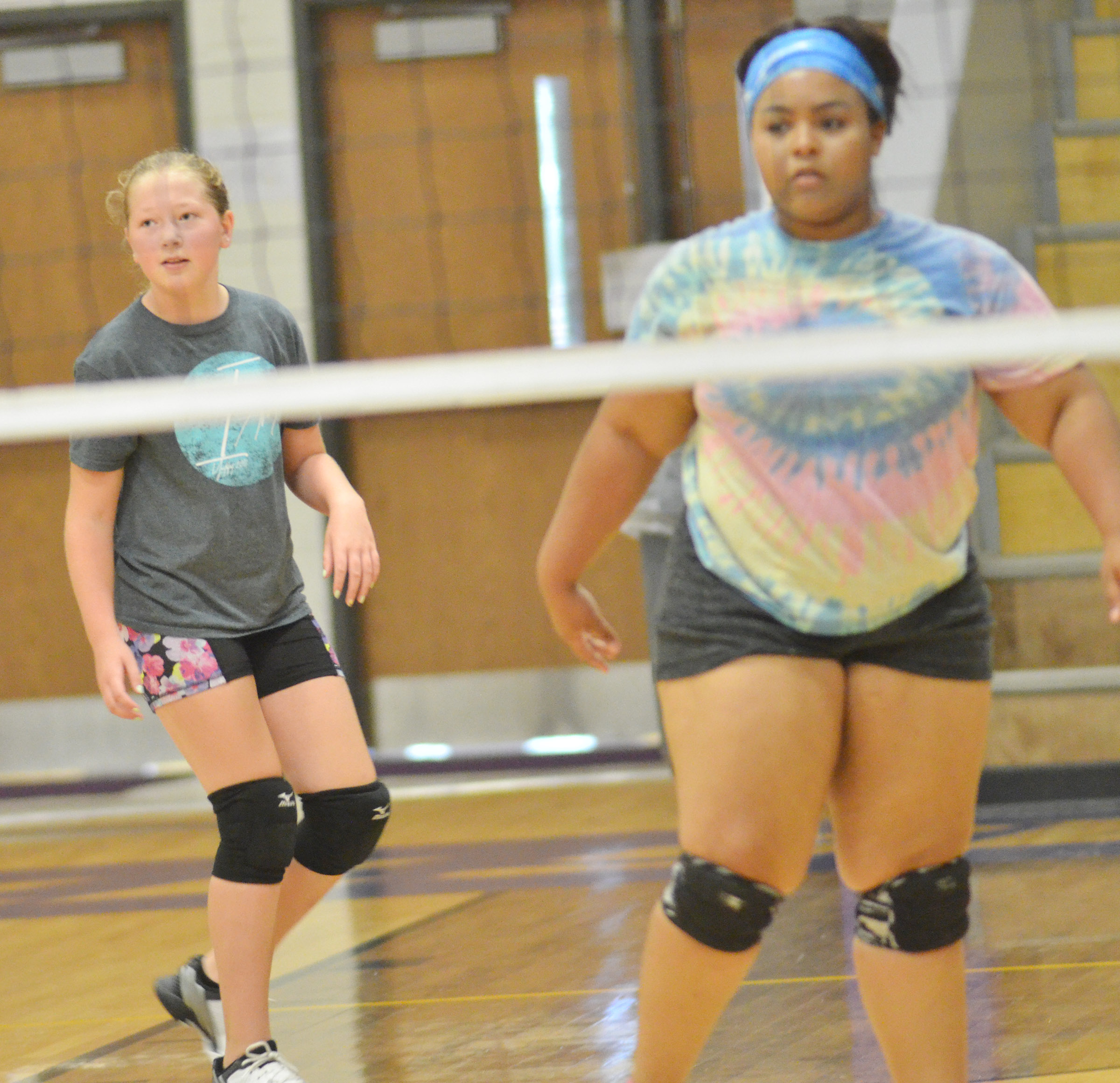 CMS sixth-grader Ava Hughes scrimmages with CHS junior Natalie Caldwell.