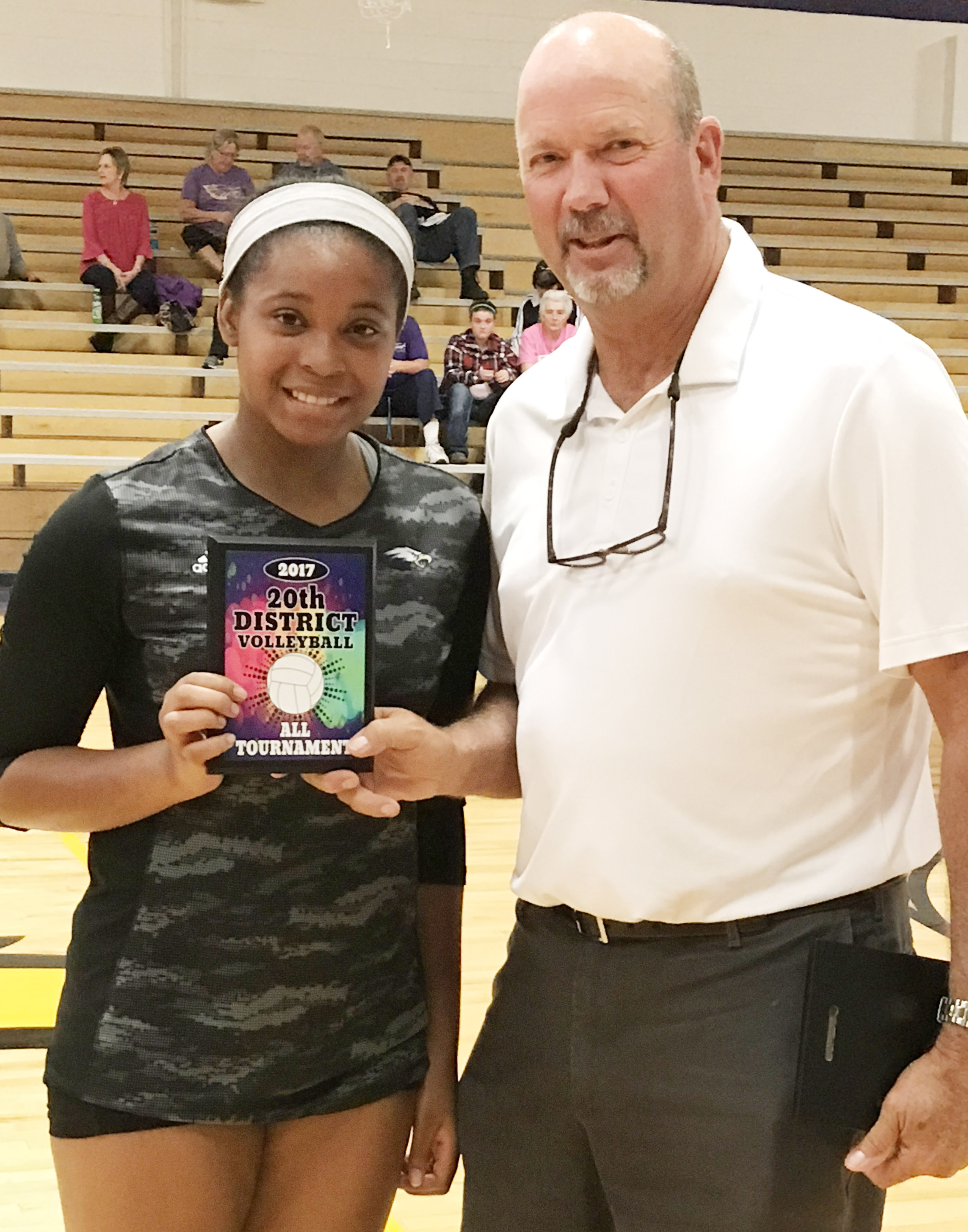 CHS senior Vonnea Smith is named to the all-tournament team. At right is CHS Athletic Director Tim Davis.