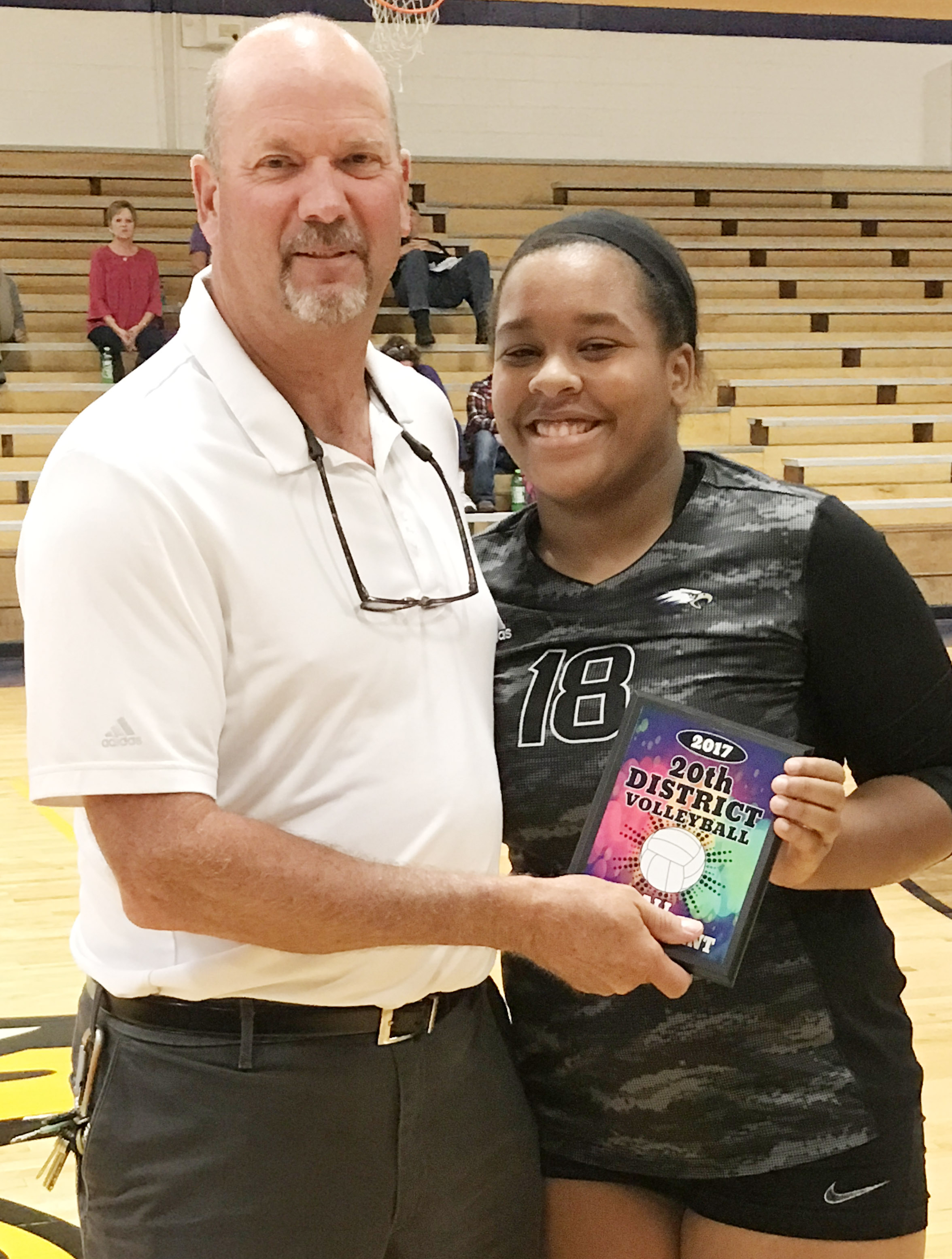 CHS senior Kayla Young is named to the all-tournament team. At left is CHS Athletic Director Tim Davis.