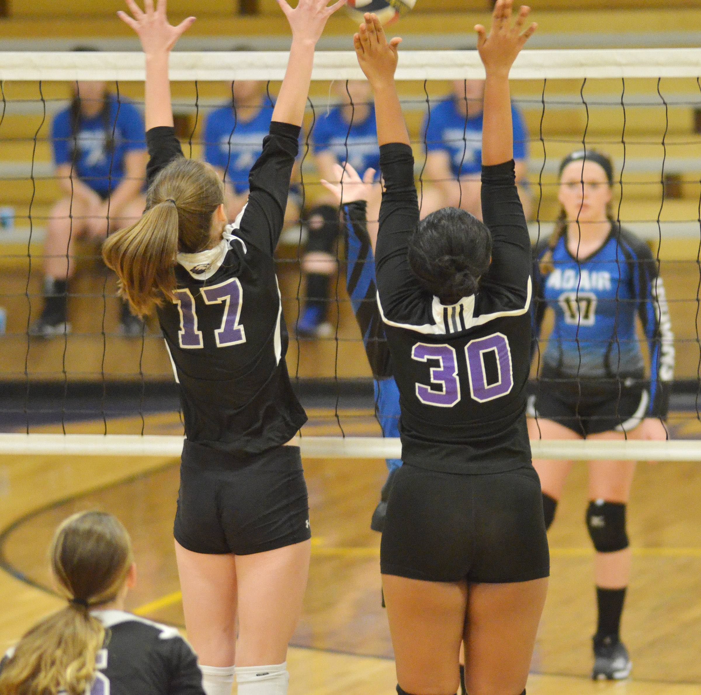 CHS junior Samantha Mason, at left, and senior Amanda Miles jump to block a shot.