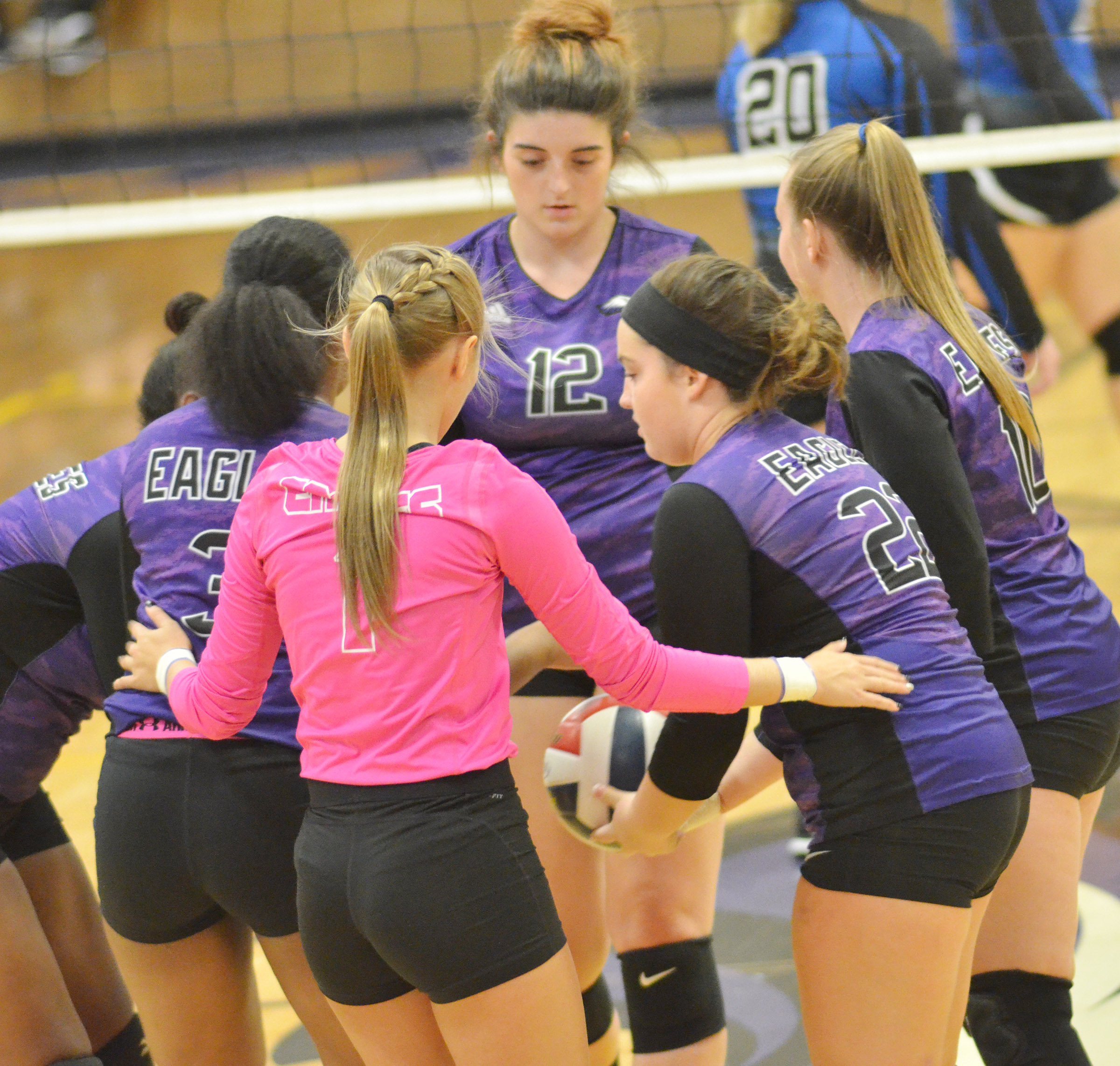 CHS volleyball players huddle before the varsity game.