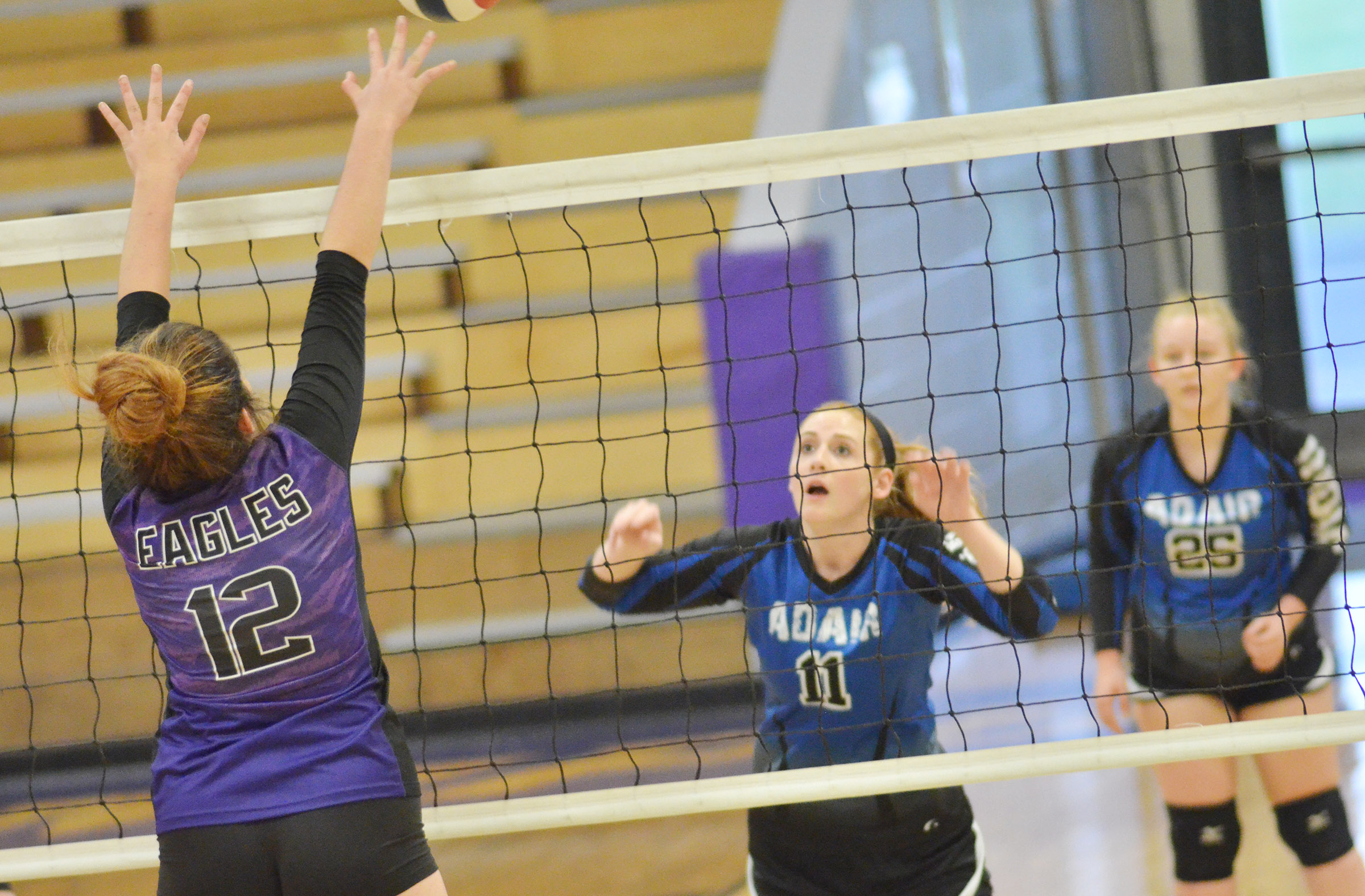 CHS senior Amanda Miles jumps to block the ball.
