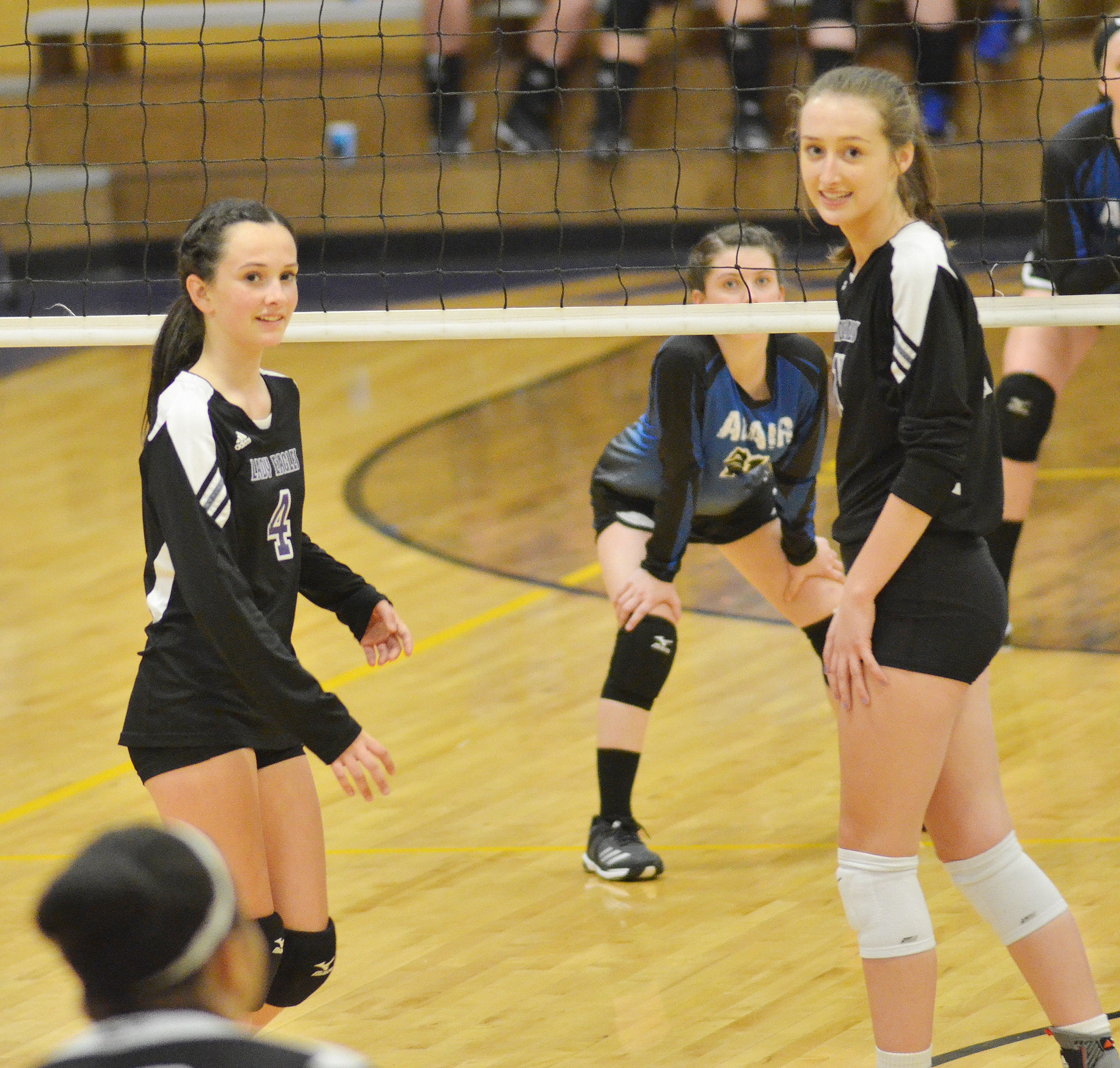 Campbellsville Middle School eighth-grader Sarah Adkins, at left, and junior Samantha Mason watch the serve.