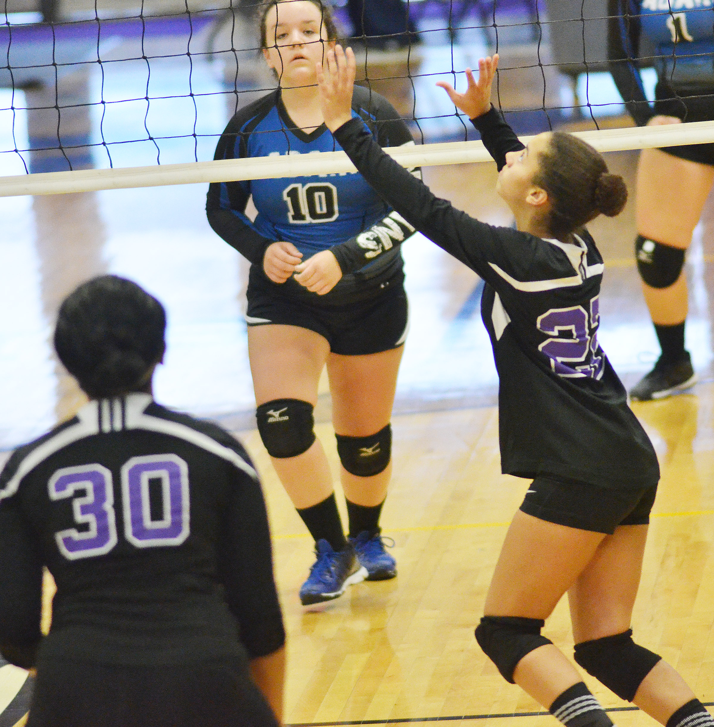CHS freshman Laci Hodgens hits the ball.