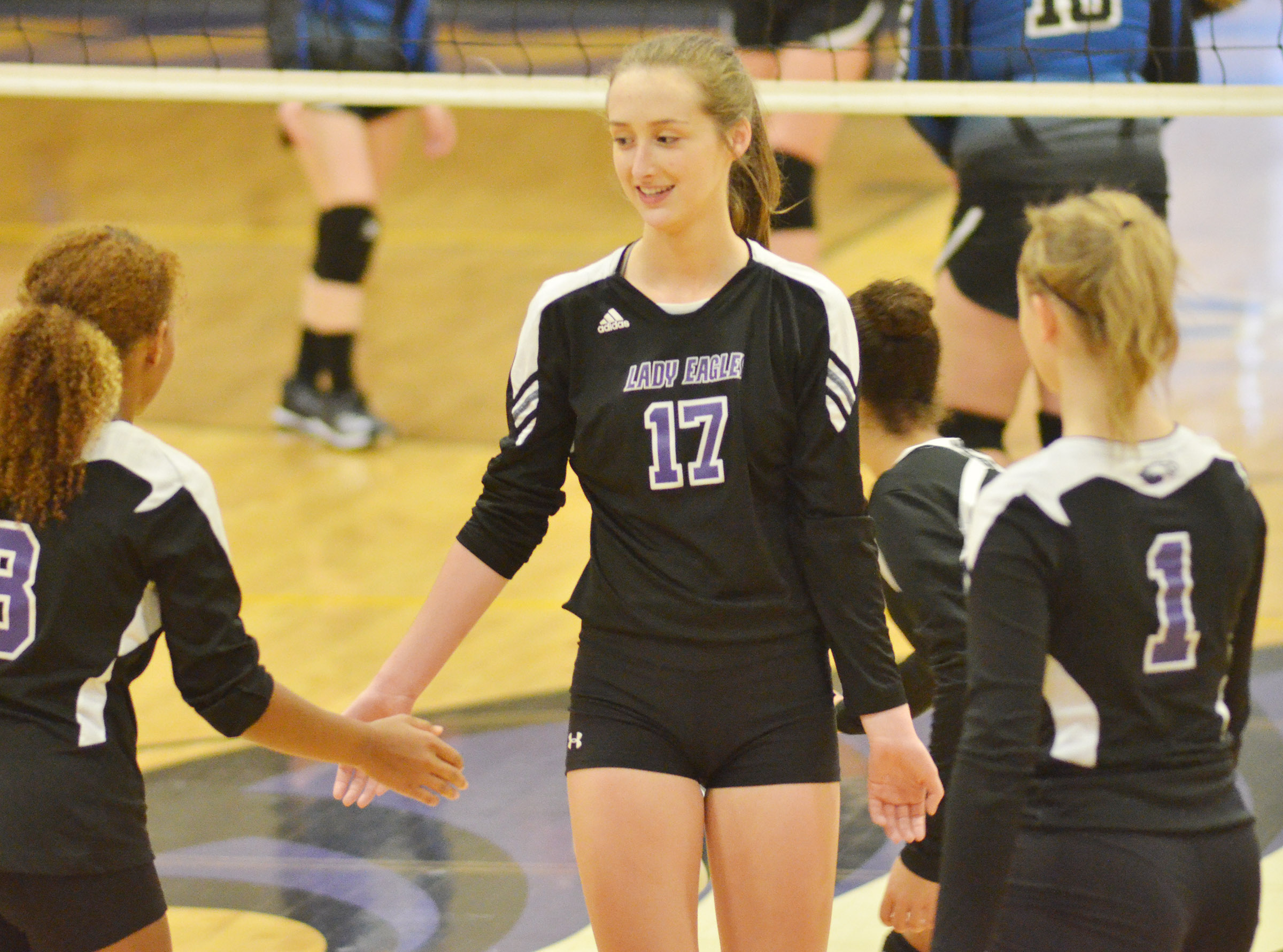 CHS junior Samantha Mason high-fives her teammates.