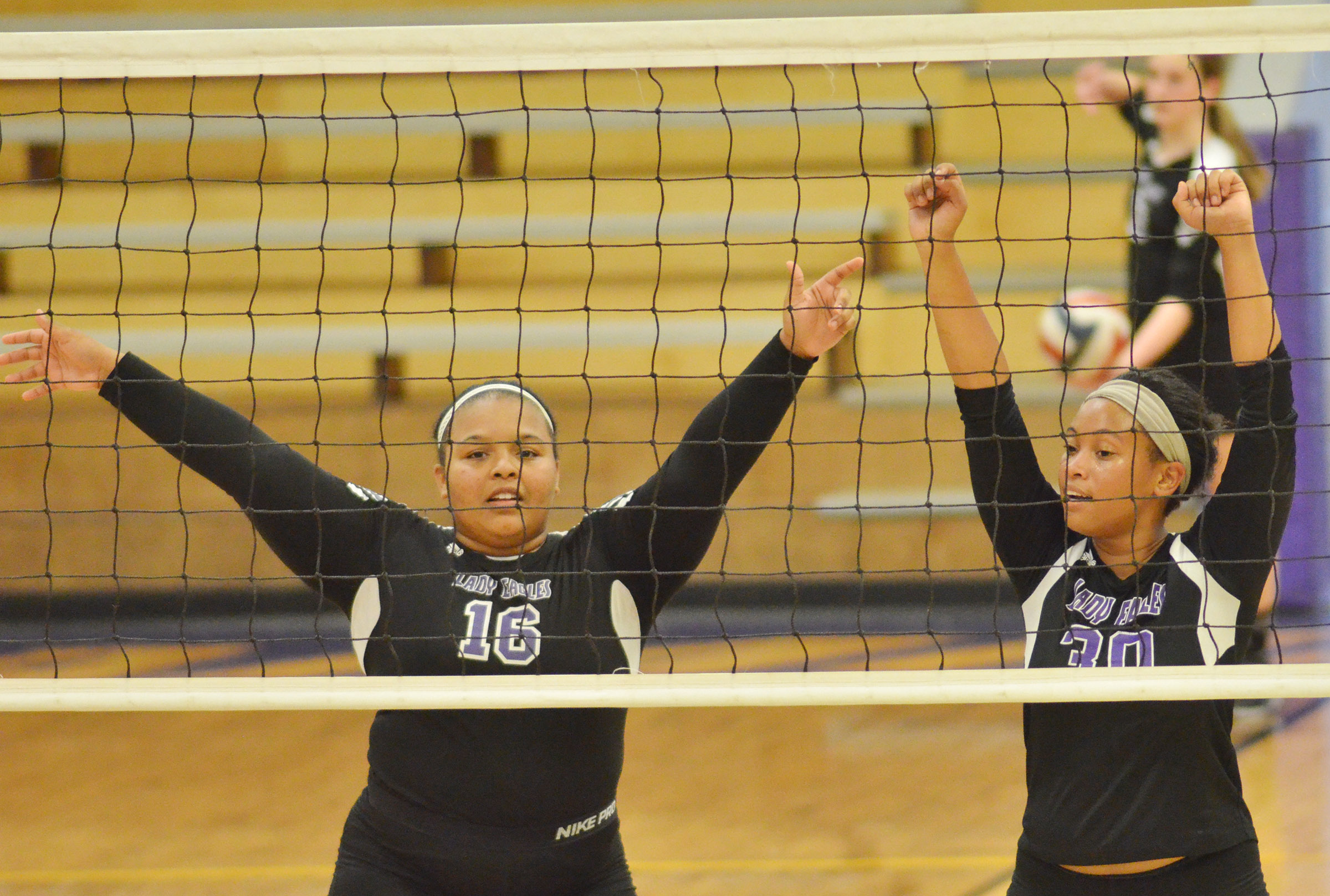 CHS junior Natalie Caldwell, at left, and sophomore Ketayah Taylor guard the net.