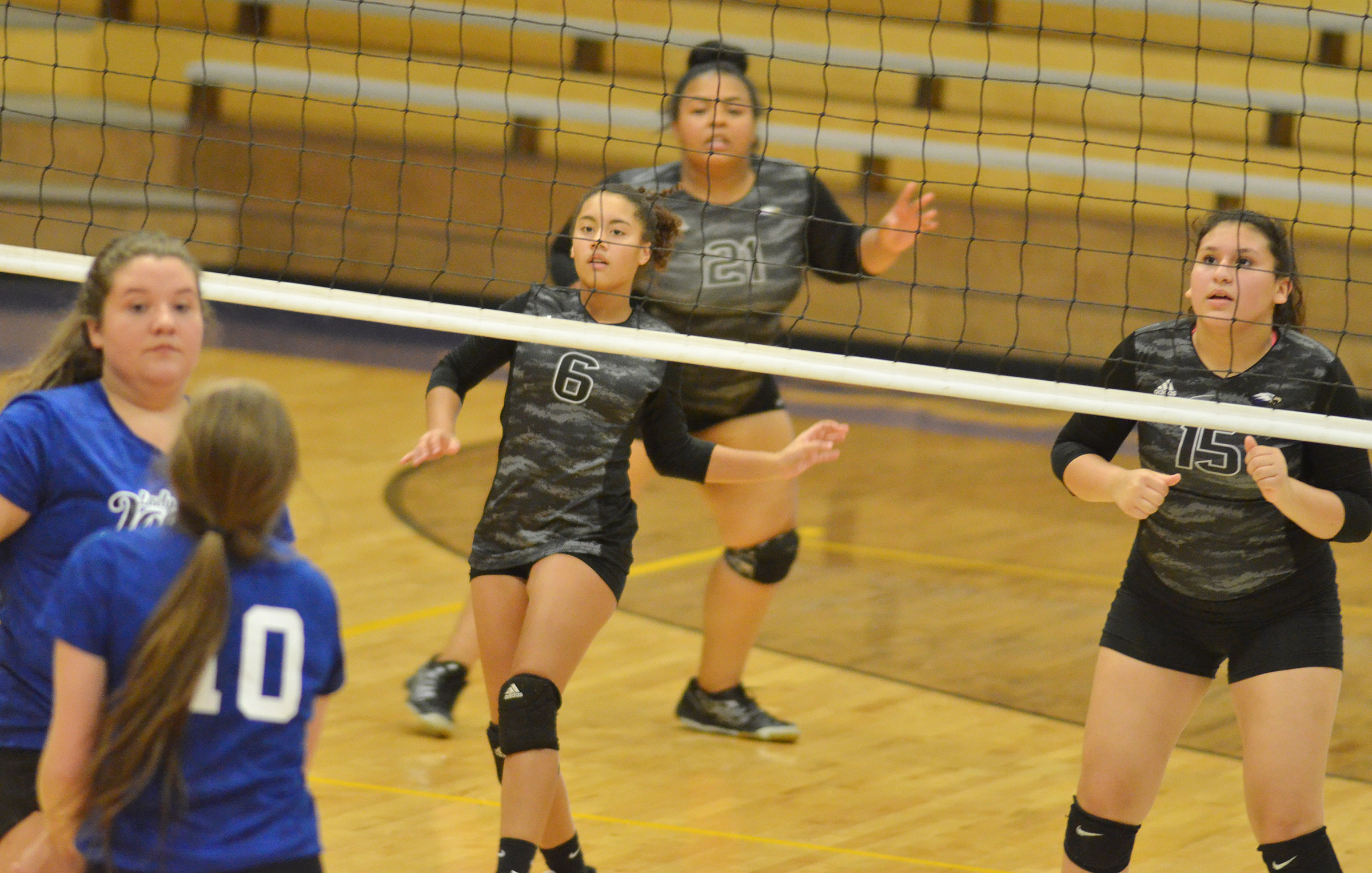 From left, CHS freshman Laci Hodges, junior Natalie Caldwell and freshman Anna Clara Moura watch the ball.