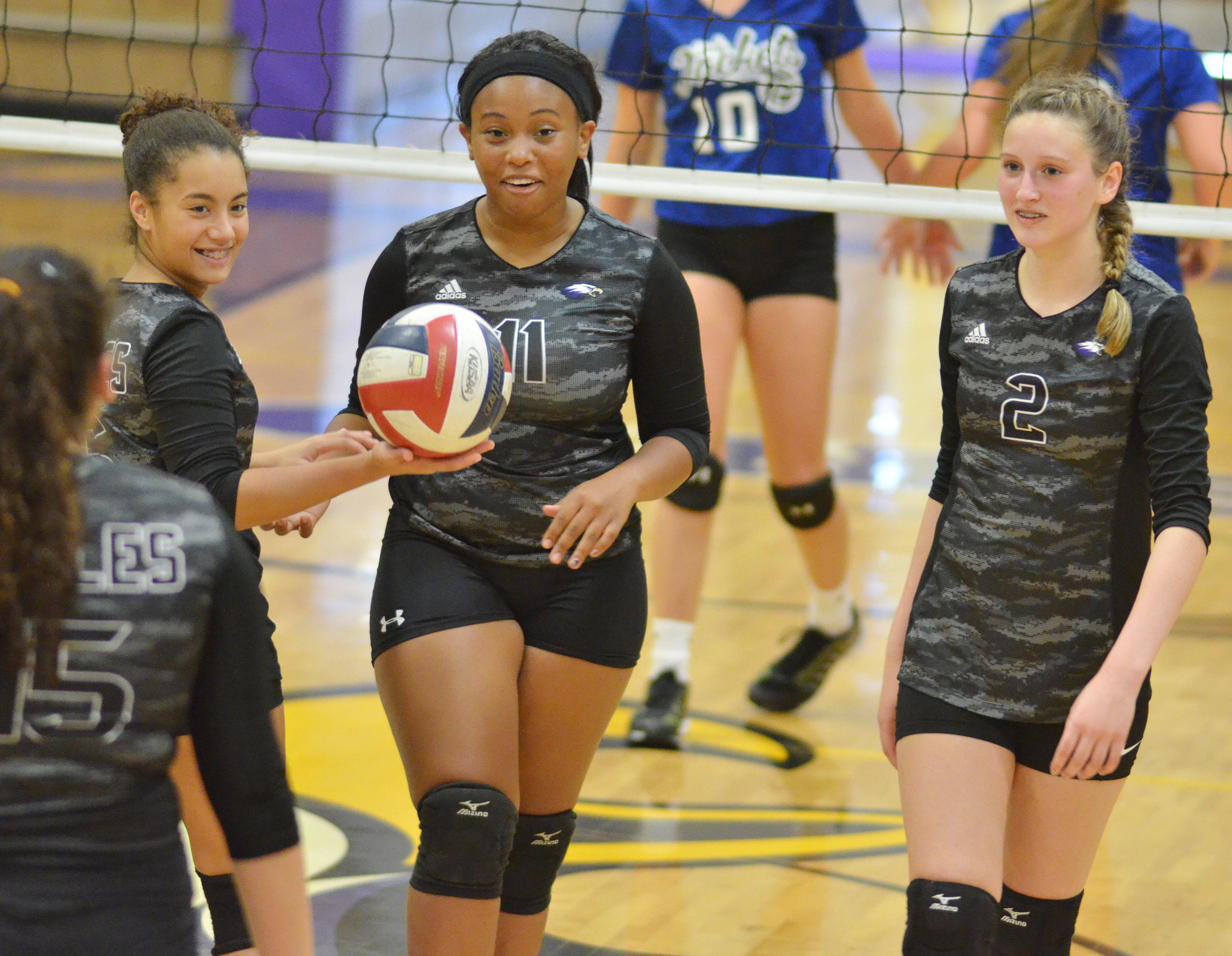 From left, CHS freshman Laci Hodges, sophomore Ketayah Taylor and freshman Zoie Sidebottom celebrate a point.