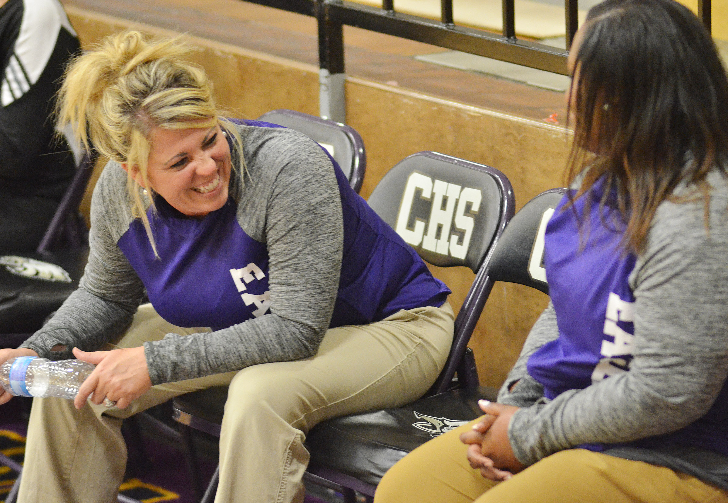 CHS head volleyball coach Elisha Rhodes, at left, shares a laugh with assistant coach Shajuana Ditto.
